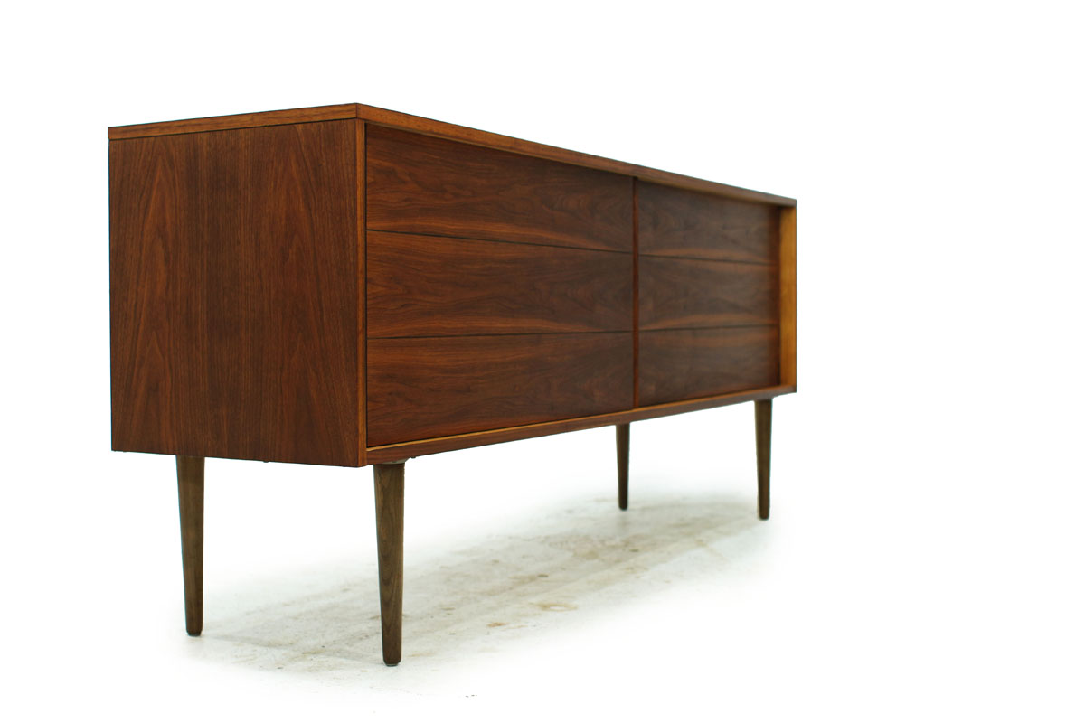 Sleek Walnut Mid Century Modern Wood Two Door Credenza with two drawers and tapered legs