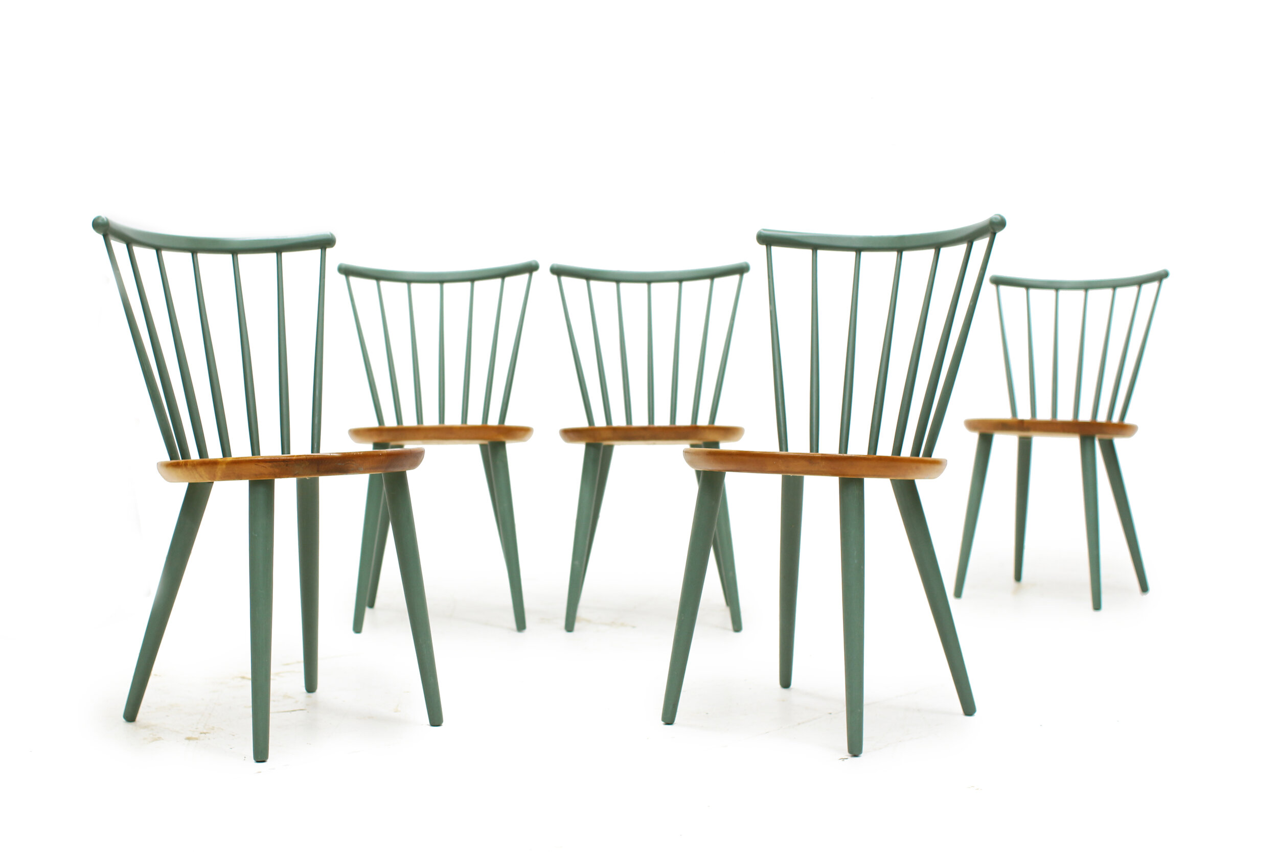 Mid-Century-Spindal-back-dining-chairs-Made-in-Sweden-by-Stocka (2).jpg