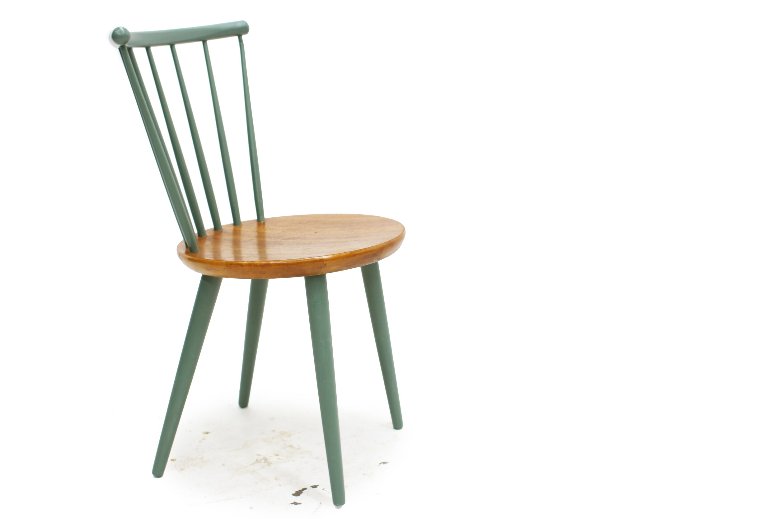 Mid-Century-Spindal-back-dining-chairs-Made-in-Sweden-by-Stocka (3).jpg