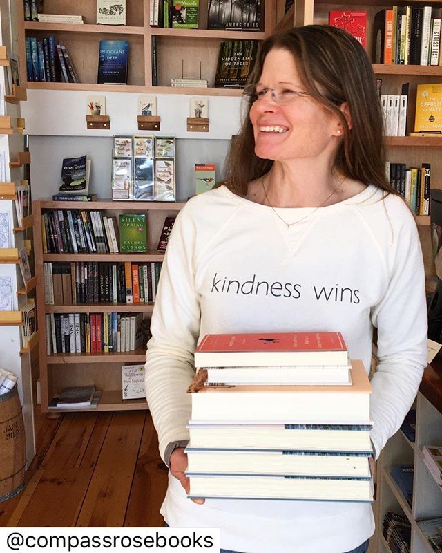 When the 21st century history of #castine is written, this intelligent, fiery woman will have a pretty fat chapter. Her shop, @compassrosebooks has become a resounding heartbeat on Main Street thanks to the books, events and people who fill its space. As a #smallbusiness lioness, she's walking the walk, and we love that. Please stop in and get lost in a latte and bestseller, or never heard of title that will knock your 🧦s off. . . . . #kindnesswins #lingowares #maine #bookstore #followyourheart #bethegood  #repost A crisp fall day, a stack of new books and our new favorite sweatshirt by @lingowareswell because kindness - and books- do in fact win!  #lingowareswell #compassrosebooks #visitcastine #kindnesswins #readbythesea