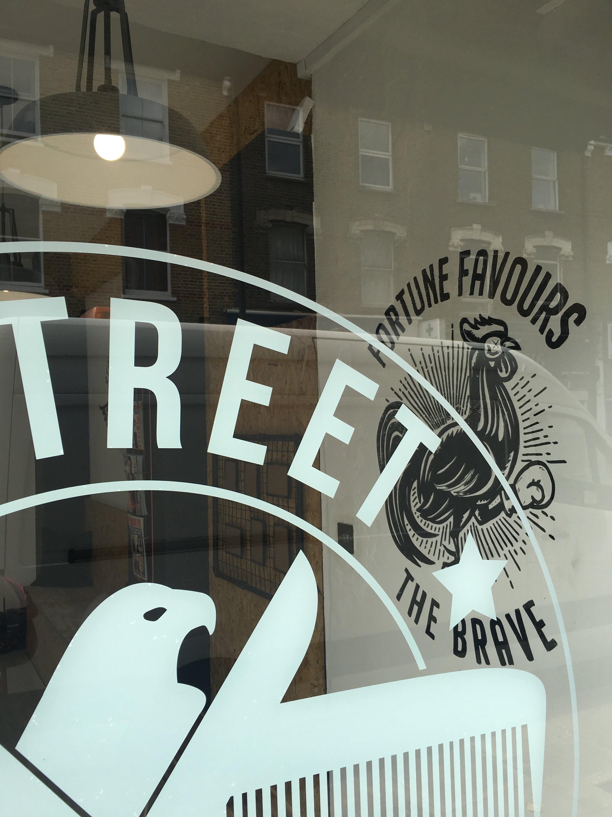 window logo at e-street barbers hackney