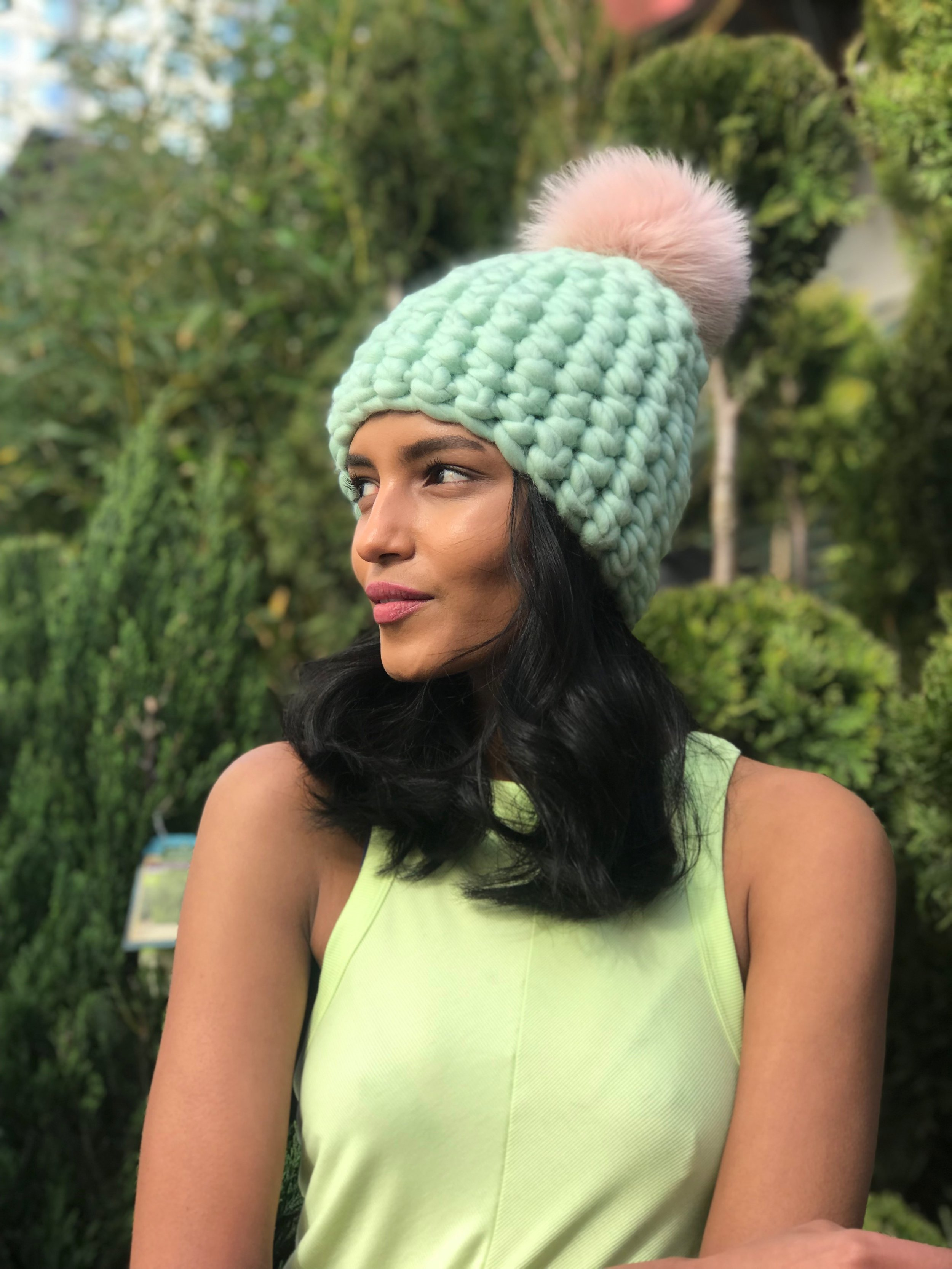shaanti is wearing   the seafoam beanie pomster with arctic pink pom
