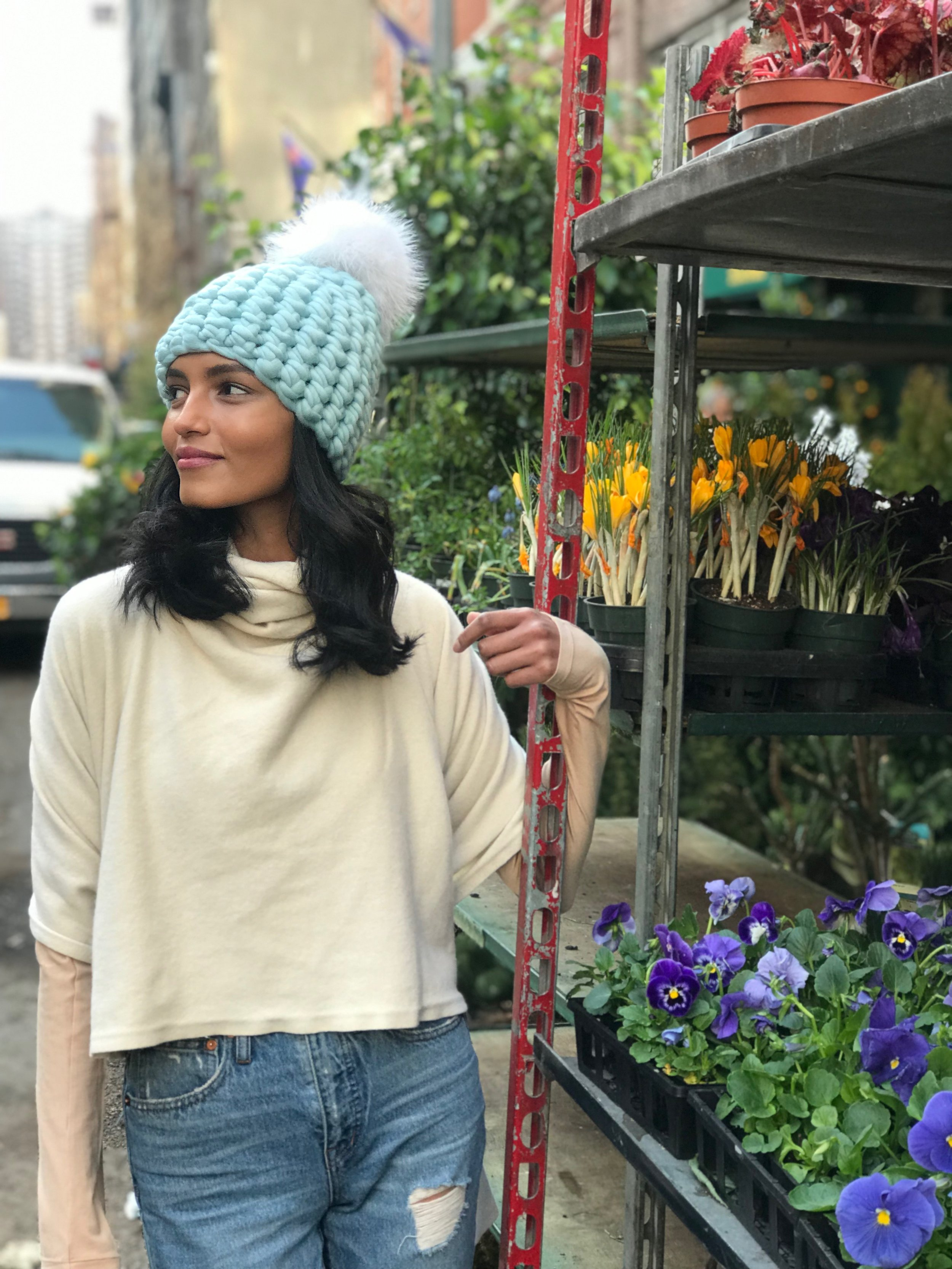 shaanti is wearing  the ice beanie pomster with arctic white pom
