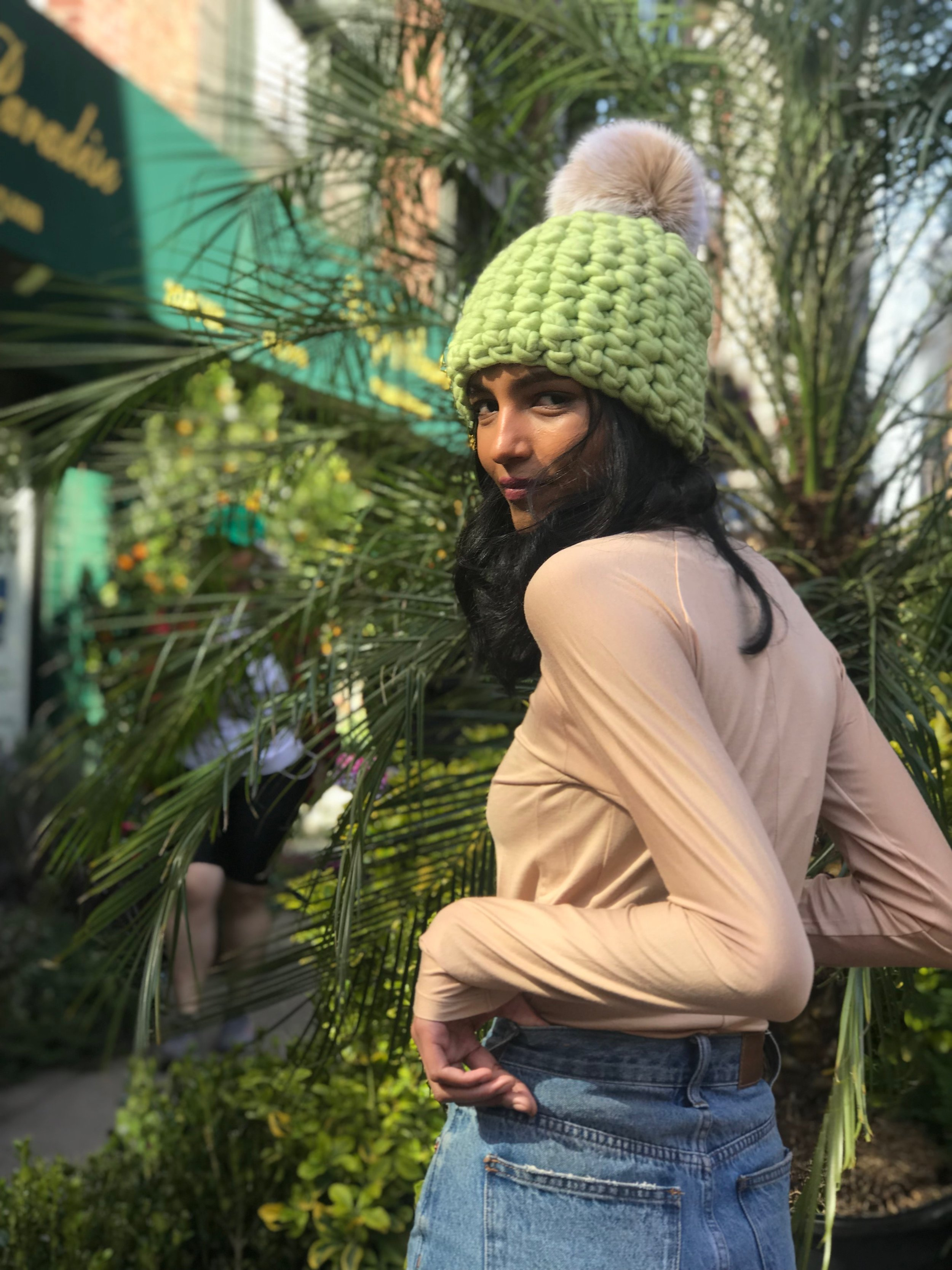 shaanti is wearing the  spring beanie pomster with a blush pom