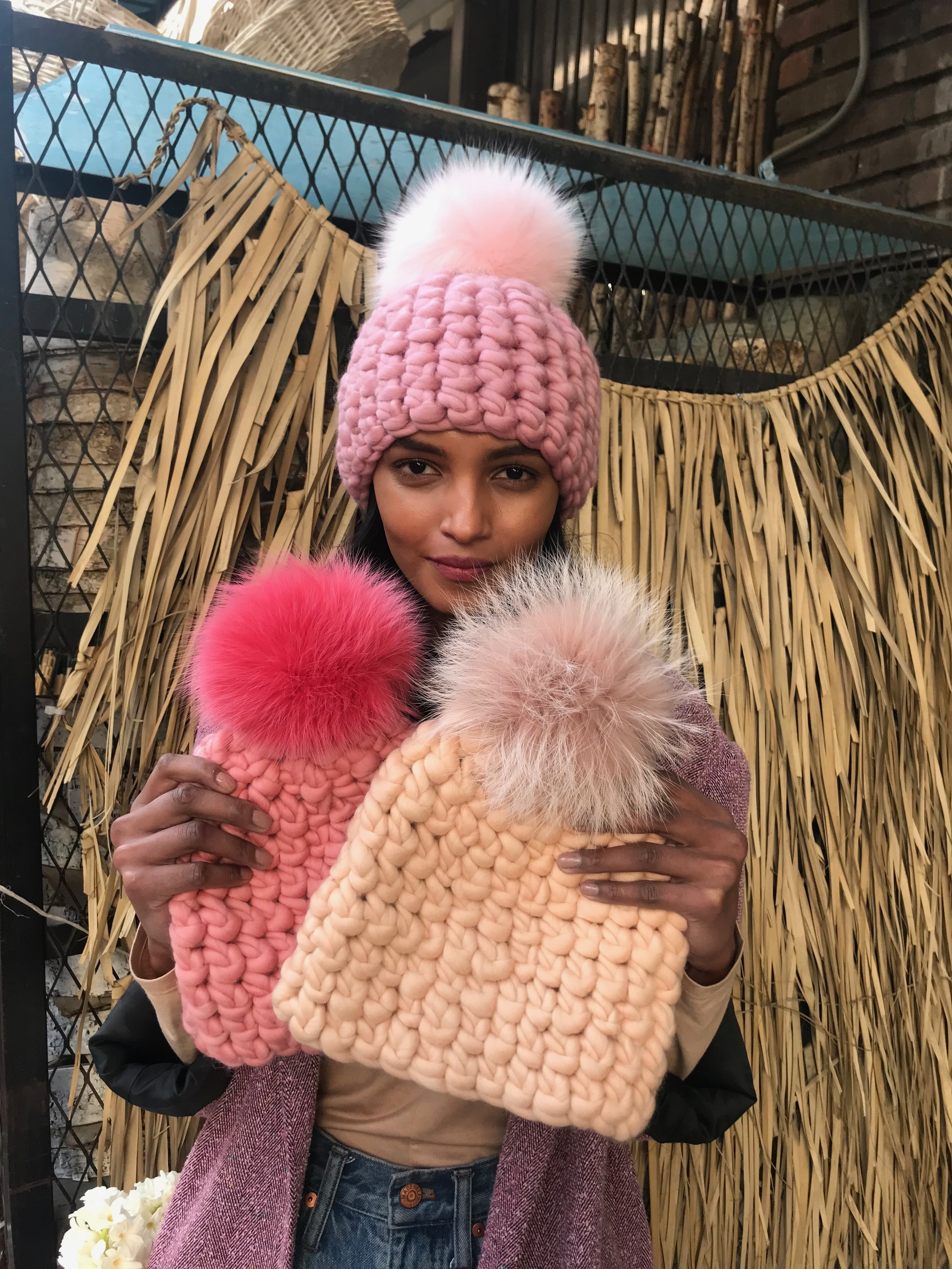 shaanti is wearing   the dusty rose beanie pomster with baby pink pom