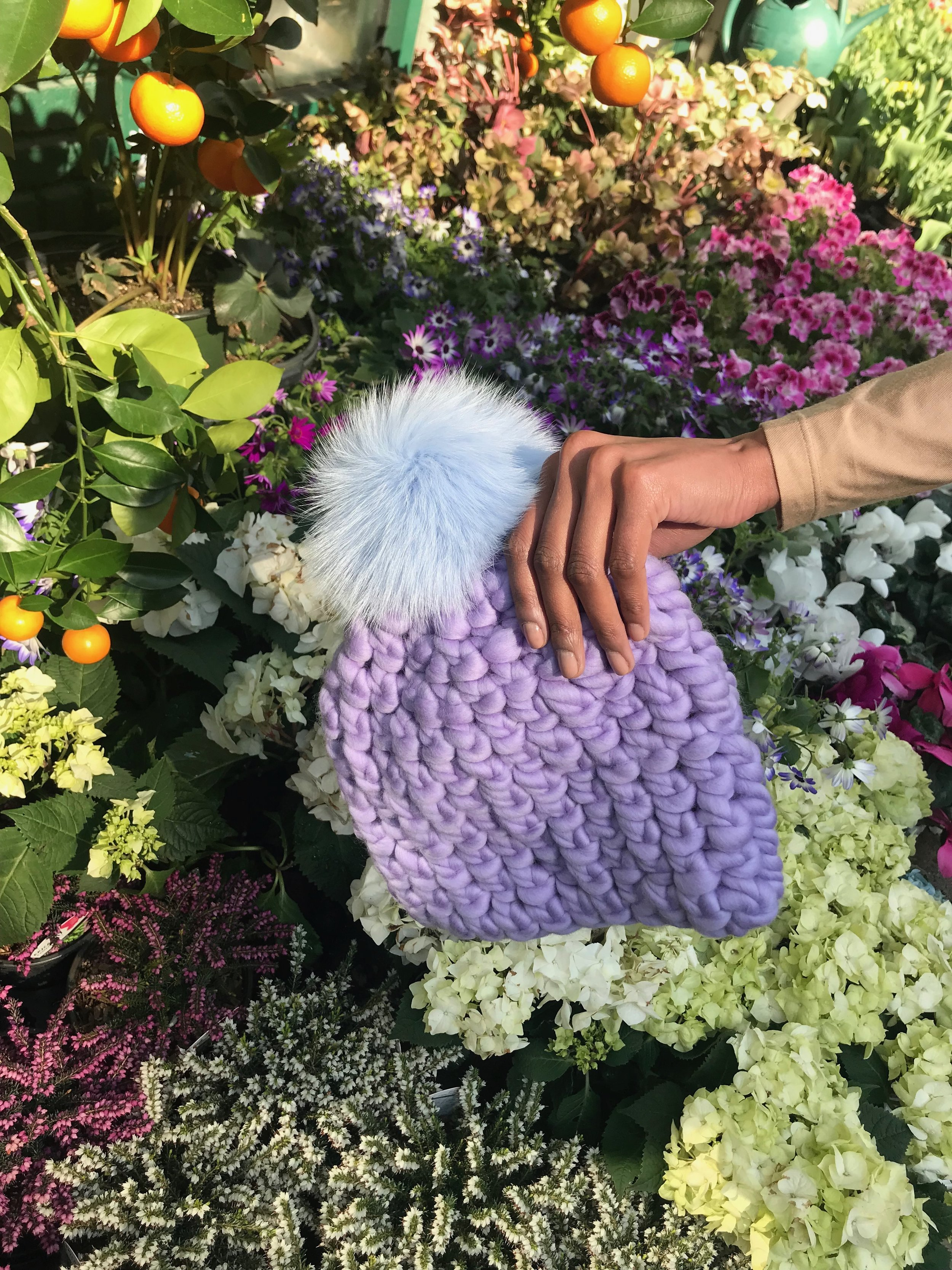 shaanti is wearing  the iris beanie pomster with baby blue pom