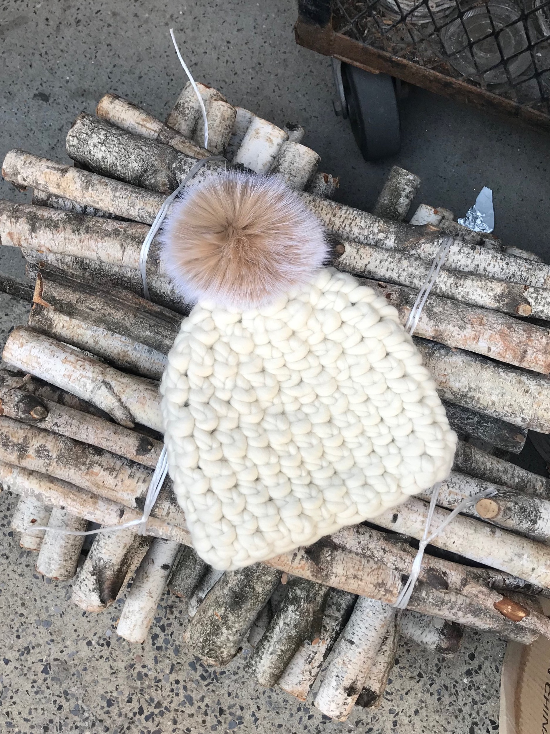 shaanti is wearing  the white beanie pomster with blush pom