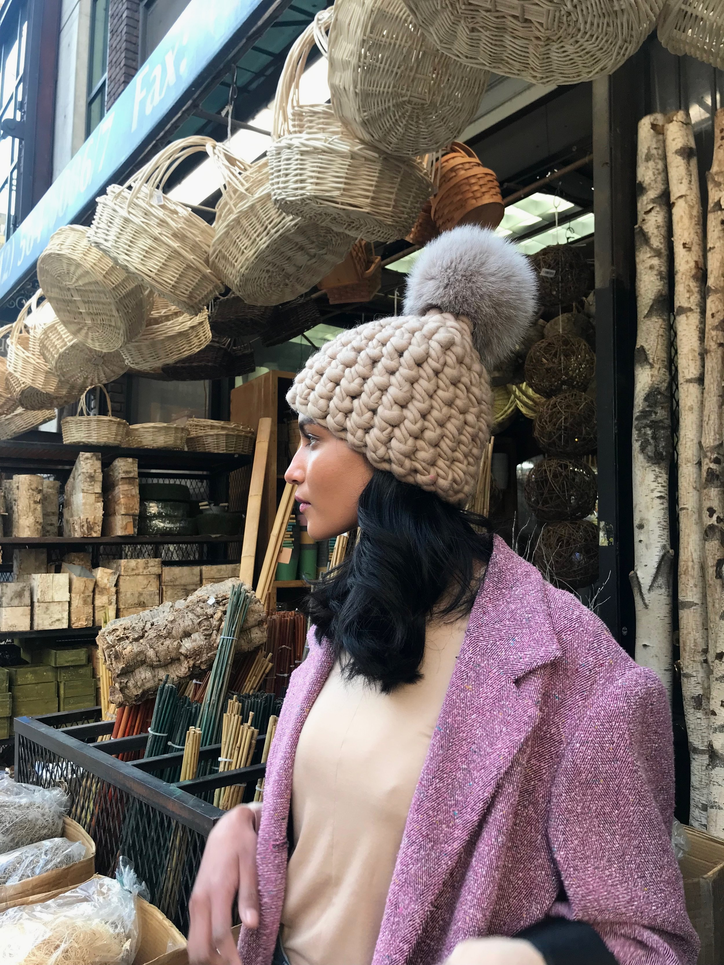 shaanti is wearing  the au lait beanie pomster with taupe pom