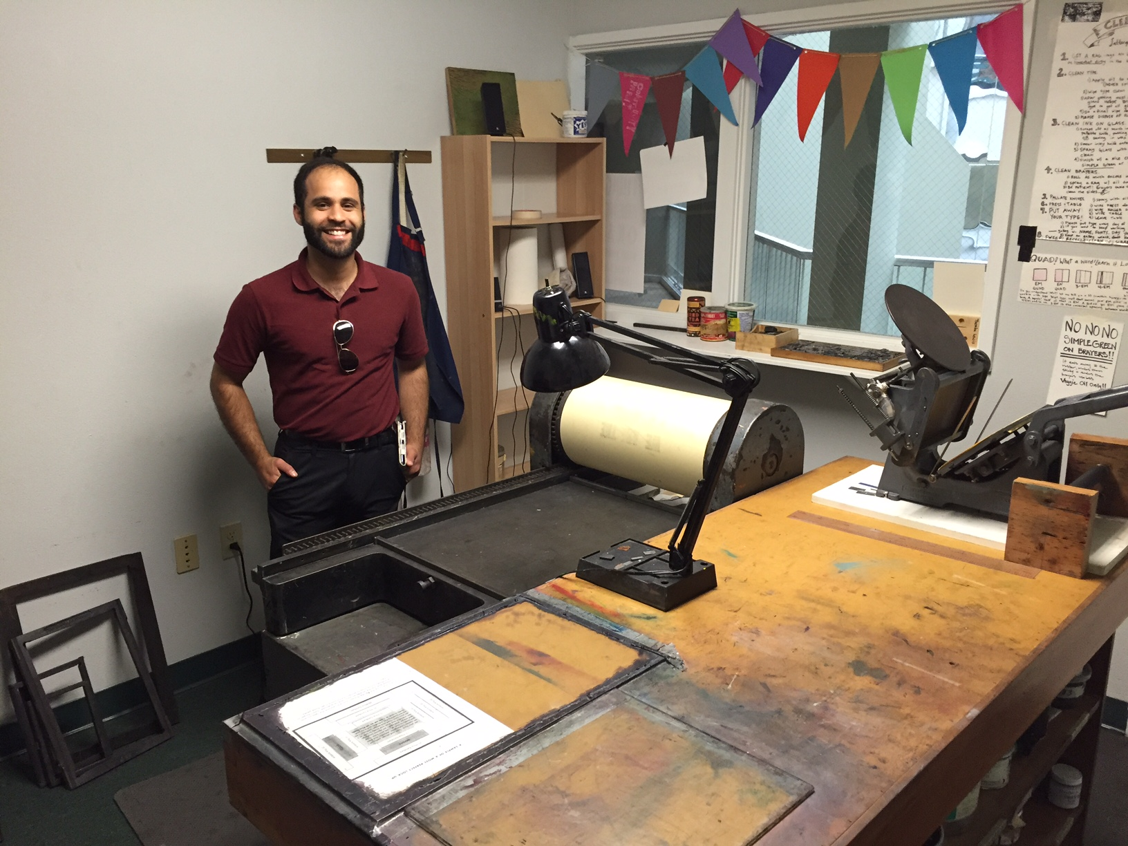 Genemichal Lauria in front of a huge letterpress!