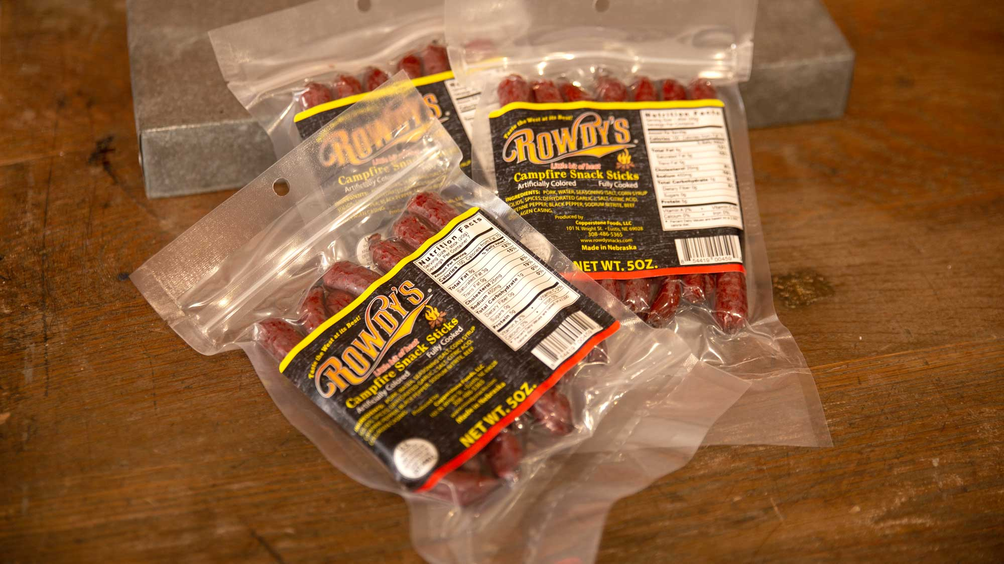 Rowdy's Campfire Snack Sticks  - Also new to the Rowdy's family! Again, a 100% Nebraska pork product. Same basic recipe as the Smokehouse sticks but with just enough spice to warm you like a wilderness campfire!   $6.49 / 5 oz bag (7 sticks)