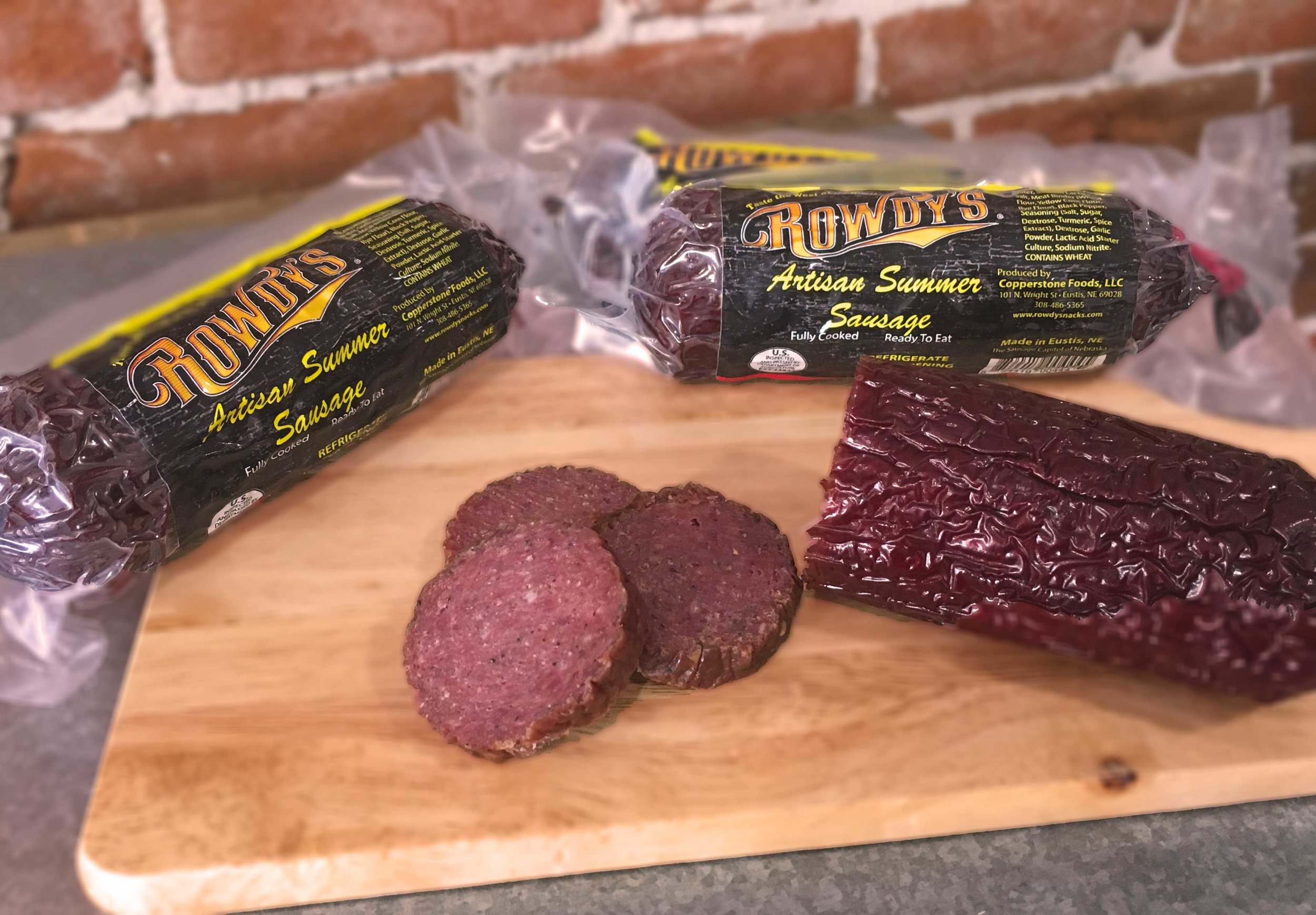 """Rowdy's Artisan Summer Sausage   – Perfect for snacking or entertaining. Enjoy the mild smoky flavor and it's lower in fat so there's no """"tallow"""" taste. German through and through! Does not need refrigeration until opened. Available locally at Knowlen & Yates and Citta' Deli.    $8.79 / chub (8 oz/chub)"""