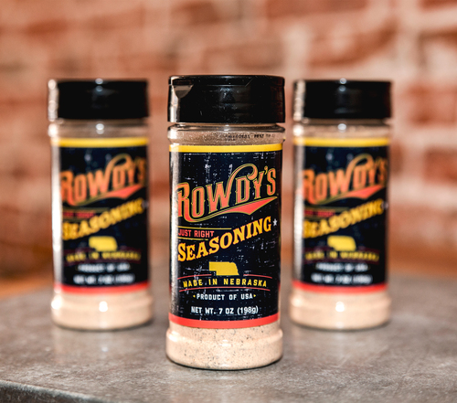 """Rowdy's """"Just Right"""" Seasoning   – With a little bit of garlic, a hint of onion, and a cowboy sized pinch of pepper, Rowdy's is perfect on beef, pork, chicken or lamb. Now everything you season is """"Just Right""""    $7.99 / bottle  (7 oz bottle)"""