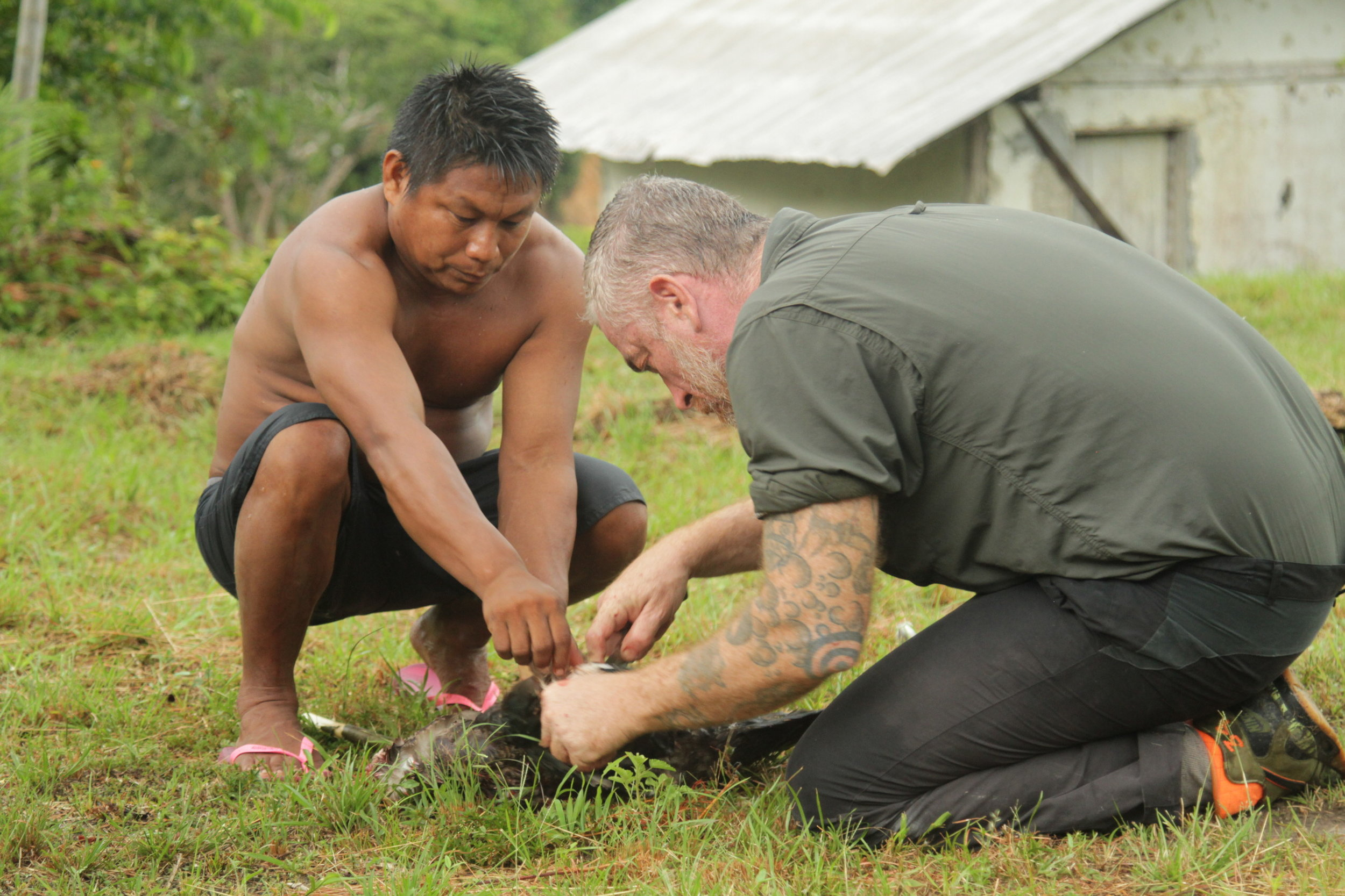 Chef Atala prepares a duck for a meal with a local tribal chieftain