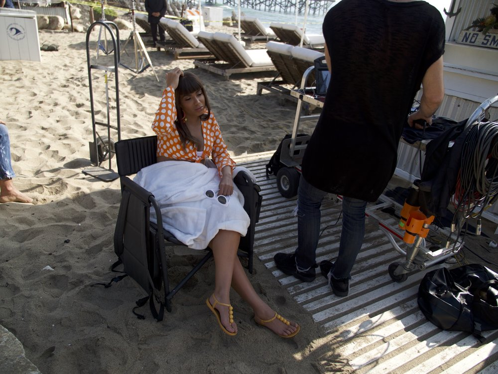 Anitta resting in between takes