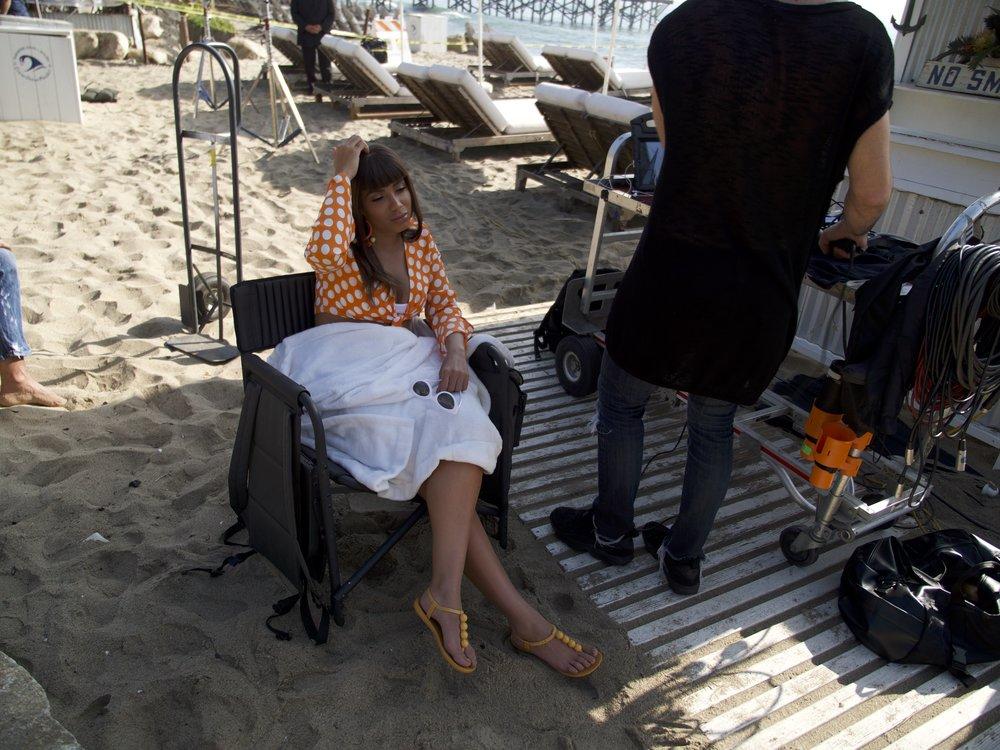 Anitta resting in between takes