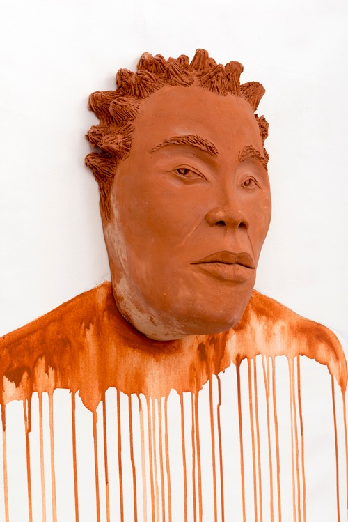 Aisha Tandiwe Bell,  He Saw the Future Coming , 2017 terra-cotta, and acrylic on canvas, 57 x 36 inches (144.78 x 91.44 cm)