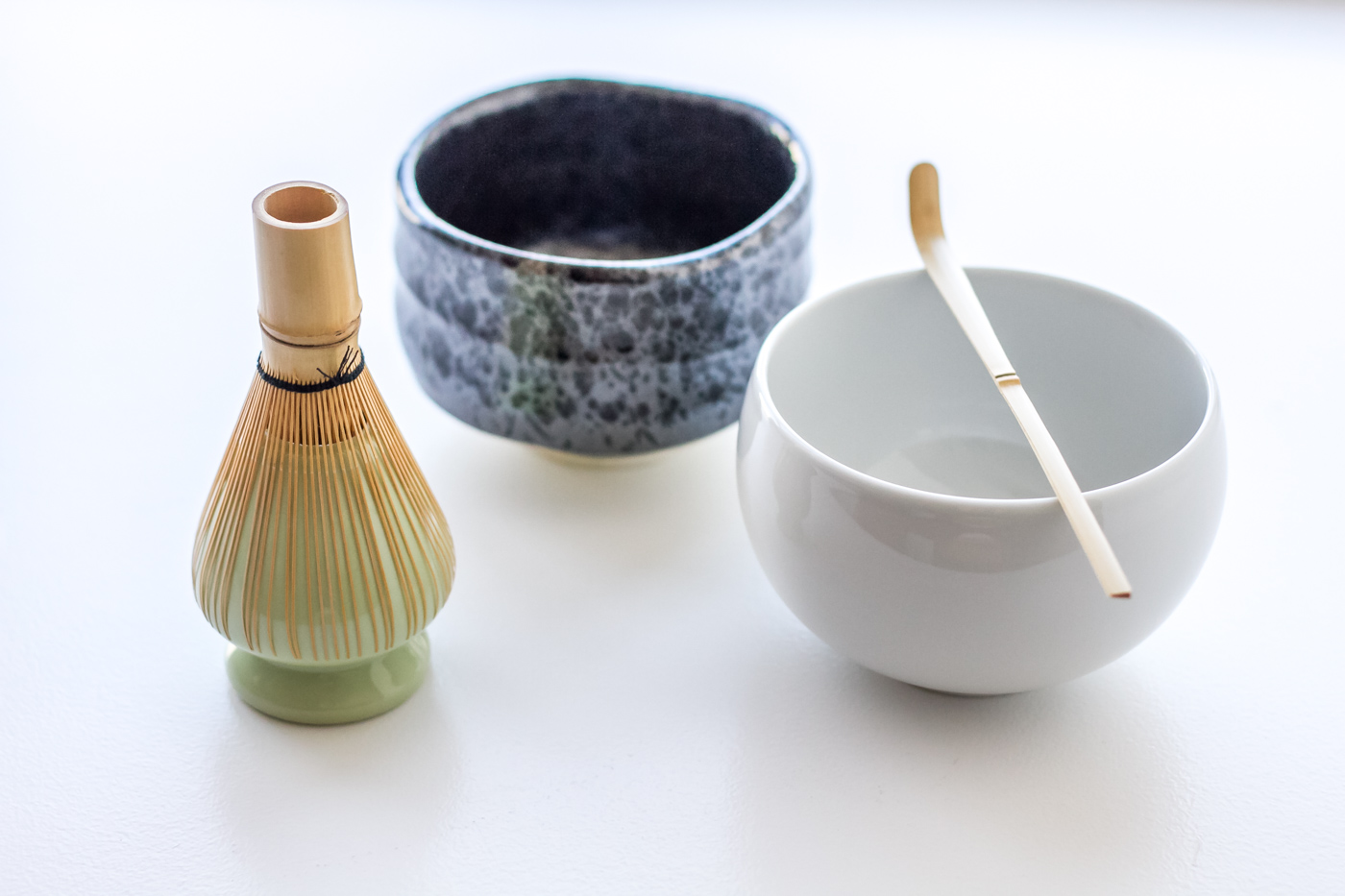 My chasen (matcha bamboo whisk) on its holder, my two chawans (matcha tea bowls) and bamboo tea scoop (chashaku).