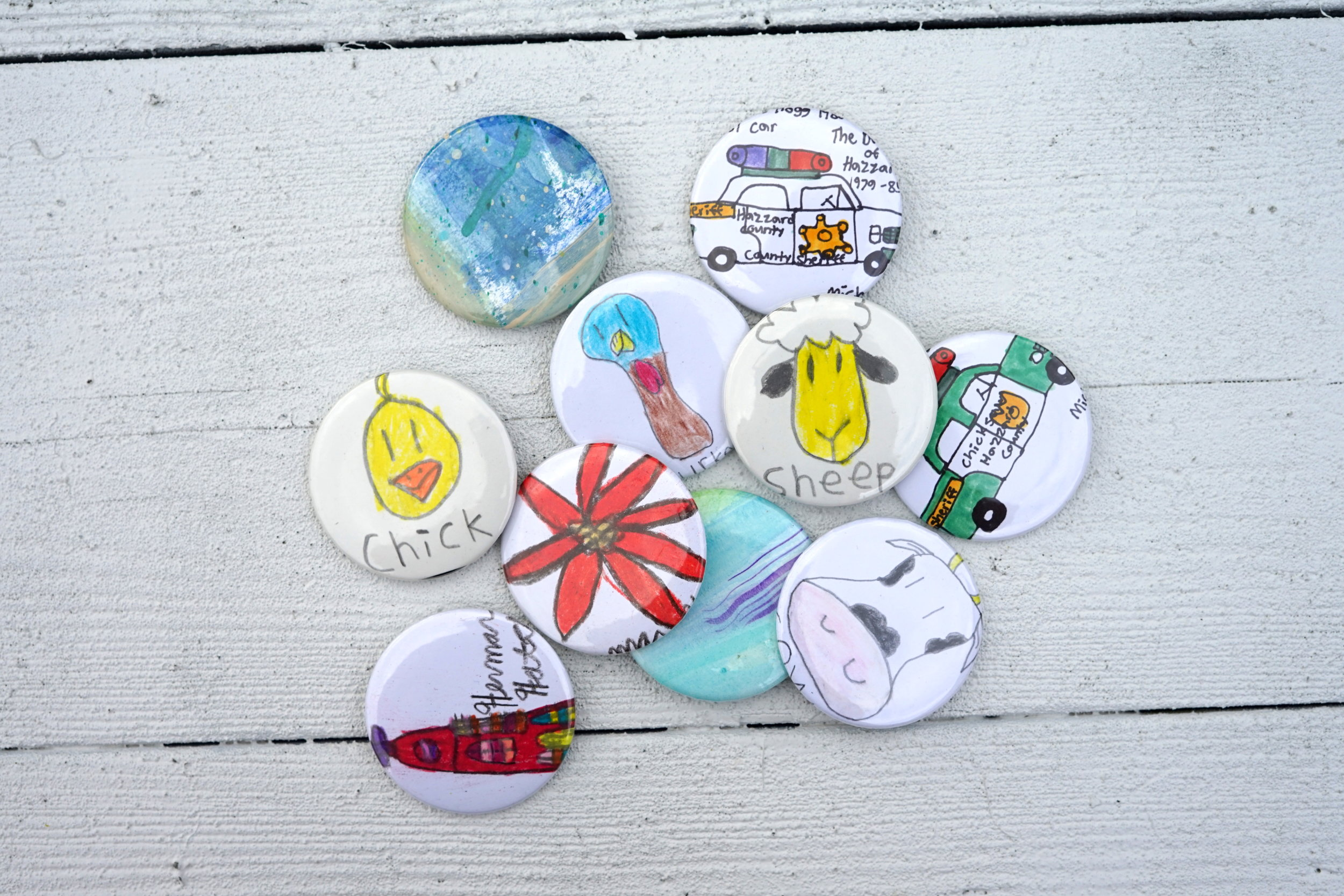 3. Donation Cards and Buttons - When you donate a minimum of $10 in someone's honor, you'll receive your choice of a Donation Card or Button (both feature an original piece of SBTT artwork). This allows you to give on behalf of someone else and have a small gift to give that represents your contribution! This is perfect for that someone on your list that has everything!