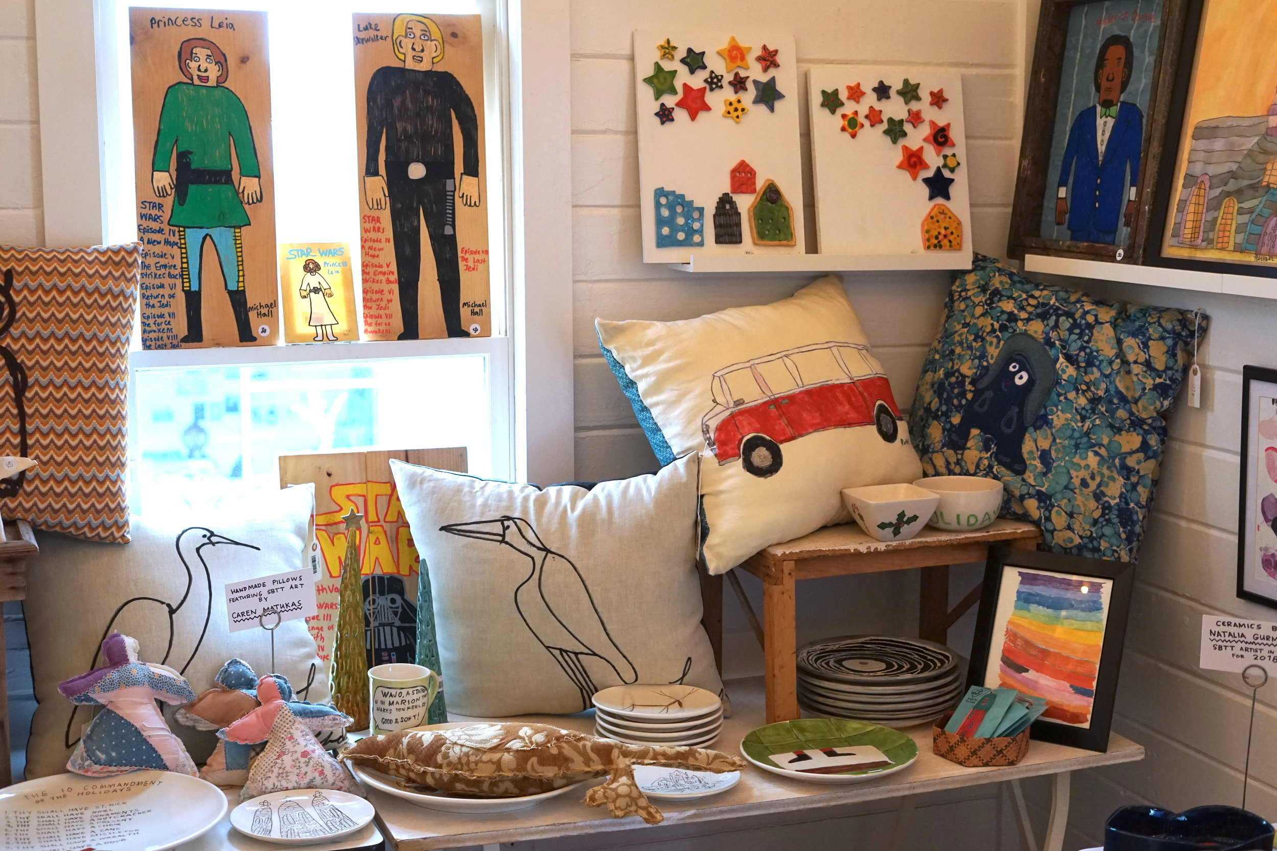 7. One-of-a-kind Gifts, Ornaments, and Ceramics - We'd be remiss to not highlight all of our great one-of-a-kind items. Whether it's Star Wars themed ornaments, adorable ceramic dog bowls, hand-dyed aprons, napkins and napkin rings, or handmade pillows and potholders inspired by SBTT art, we've got you covered.
