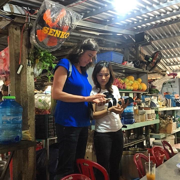 The picture of me with Tam, the Sinh Tố shop owner, shows how we are trying to understand each other using a translate app on our phones. Our apps are pretty hopeless, and we are frustrated! Tam's sinh tố is in Hoi An. A place I visit twice a day when I am staying in Hoi An. She gives fresh healthy drinks at locals prices with a smile, kindness and empathy. I just love this place!