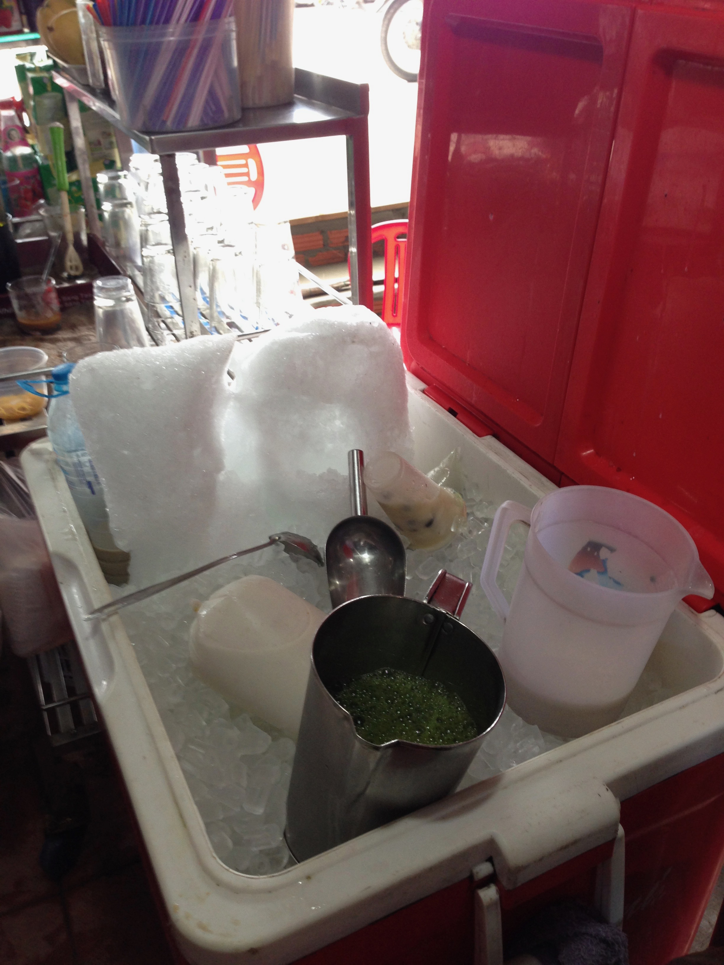 The ice is perfectly safe to consume in Vietnam. This is a relief, because ice in drinks makes them so much more enjoyable don't you think? Two types of ice are used. The finely crushed ice is served on top of the sinh to dam. A fruit salad drink with sweetened condensed milk and piled high with a dome of crushed ice. The coarser ice used to be hand bashed through a hessian bag to crack it from a large block with a wooded mallet by Tams father. Now it arrives already in pieces.
