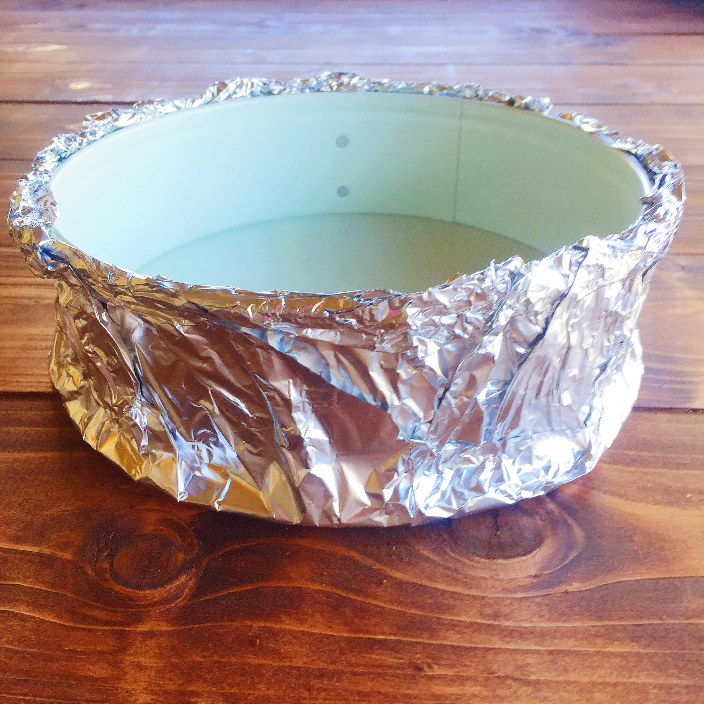Wrap your spring form pan in several layers of foil.