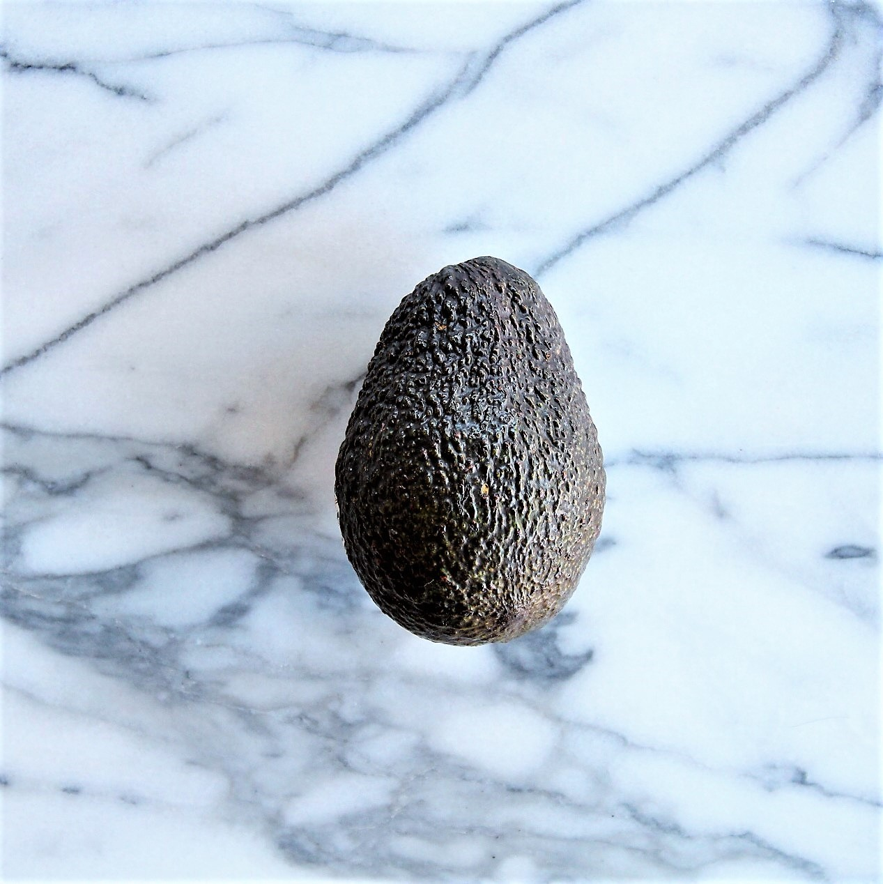 Select a ripe but firm avocado.