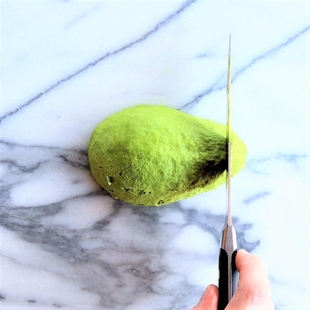 Using a sharp knife, make vertical slciecs on your dominant hand side