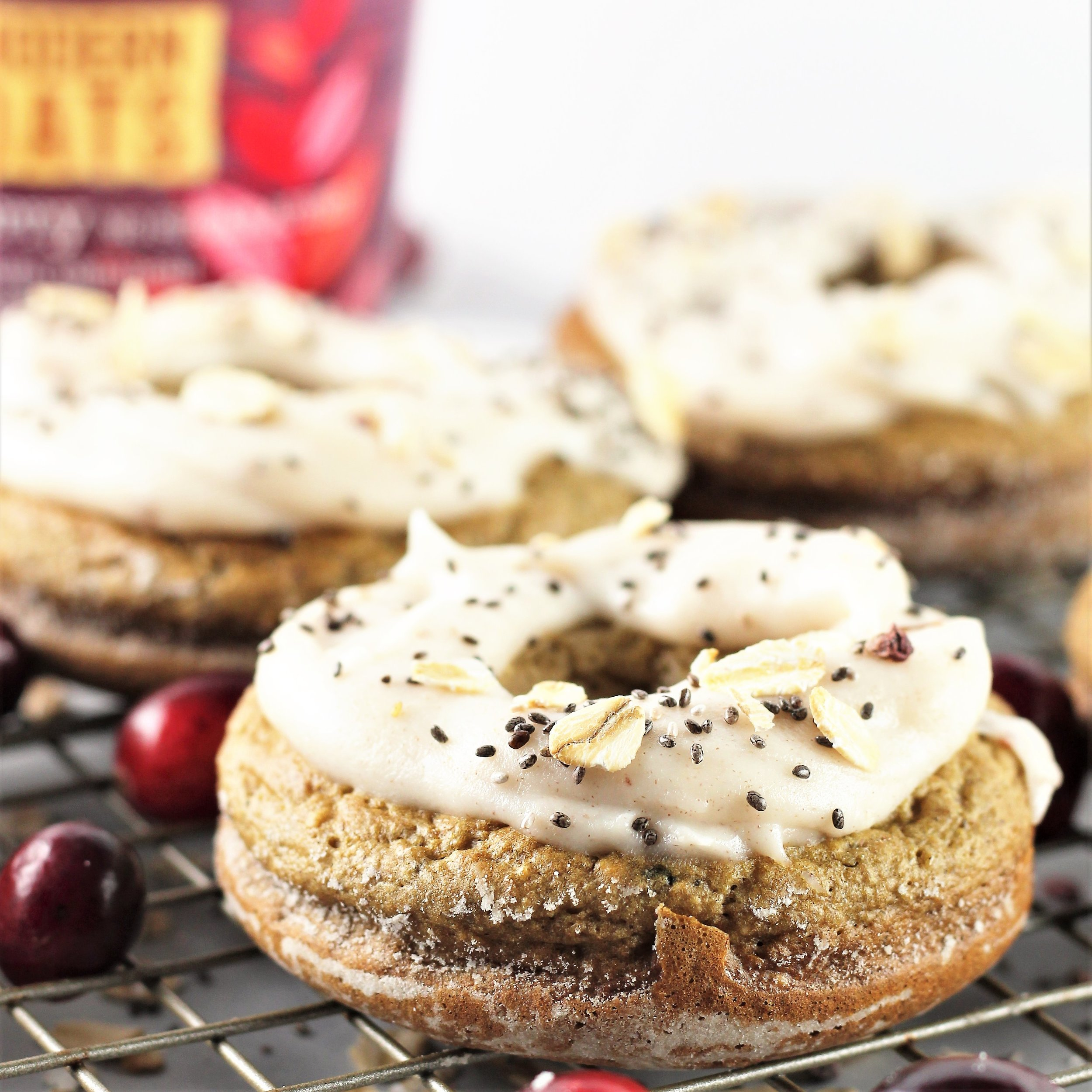 cranberry oatmeal donuts with coconut date icing