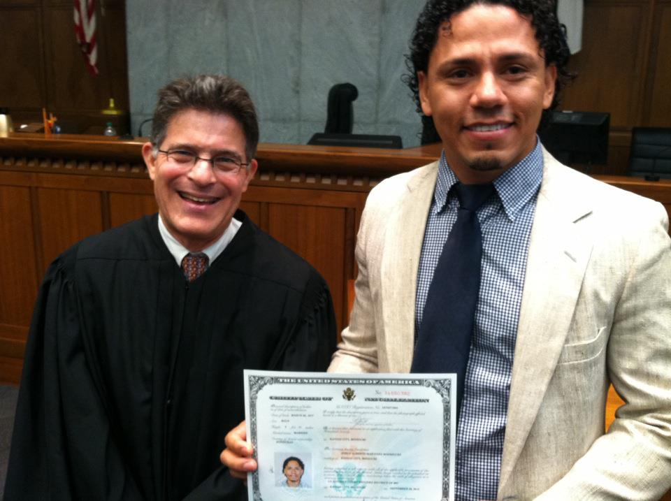 "Andrea's husband Jorge at his naturalization ceremony (Andrea's first ""client""!)"