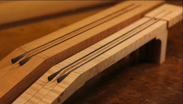 Guitar necks with carbon fiber (fibre) reinforcing rods from 'The Art of Lutherie'.