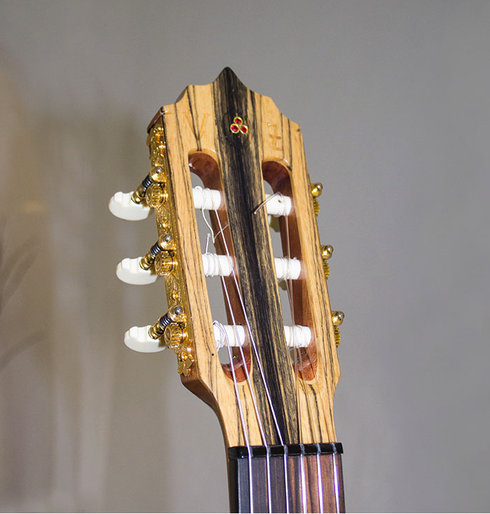 All headstocks need 3 Birmanian Rubies mounted in 18kt gold don't they?