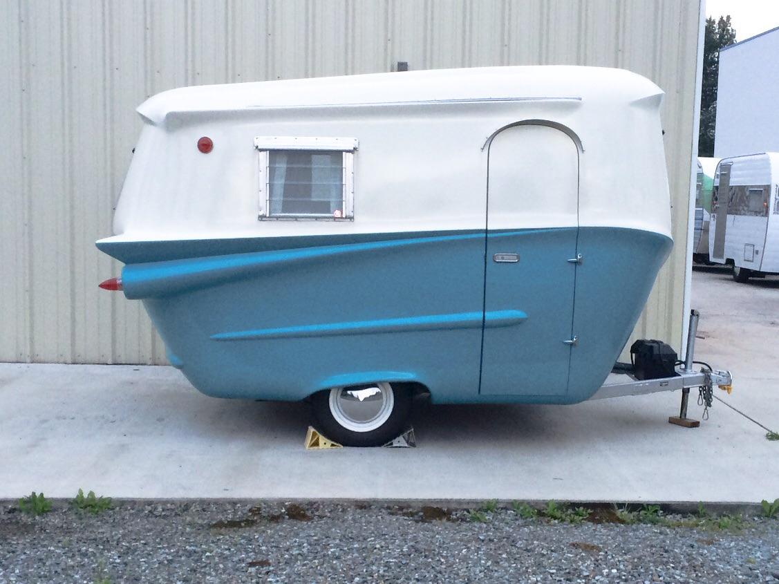Yep, trailer and RV doors have and are always on the RIGHT! And isn't it just adorable?