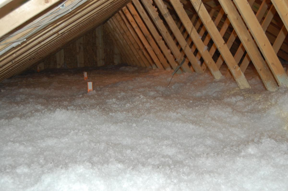 Loose-fill insulation is installed to the specified depth.jpg