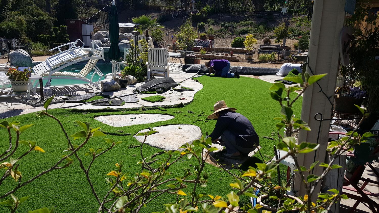 Artificial Grass Is A Good Choice Whether Rain Or Shine Quality Home Improvement.jpg