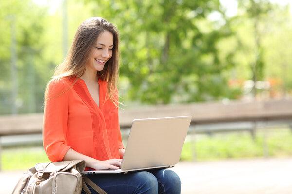 Happy-girl-using-laptop.jpg