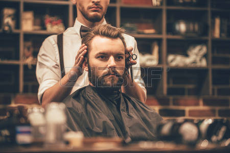51259659-looking-amazing-close-up-of-hairdresser-checking-symmetry-of-haircut-of-his-client-at-barbershop.jpg