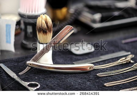stock-photo-barber-tools-close-up-of-elegant-old-brush-with-white-handle-for-shaving-and-range-of-old-268414391.jpg