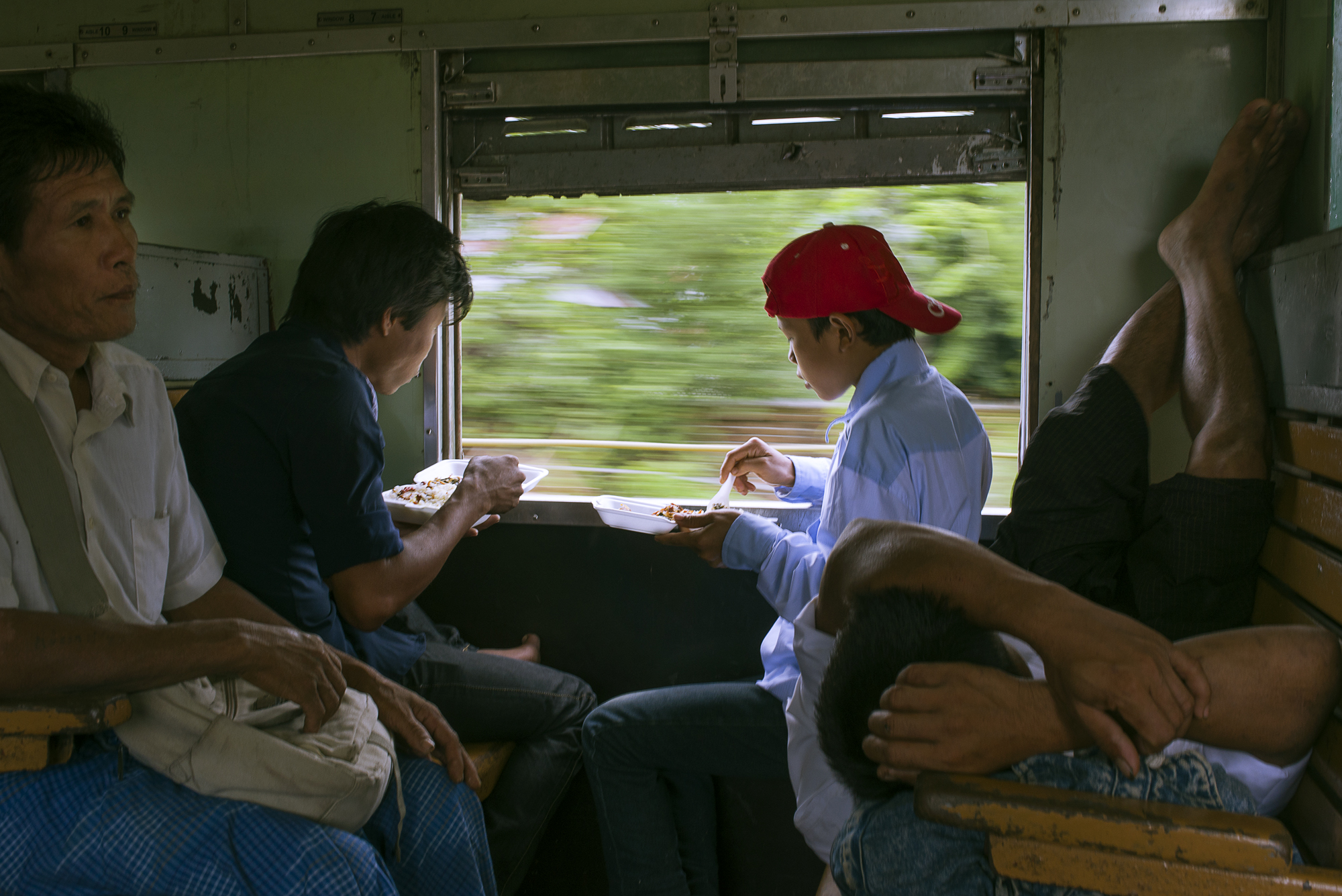 A family eats lunch on the economy class carriage