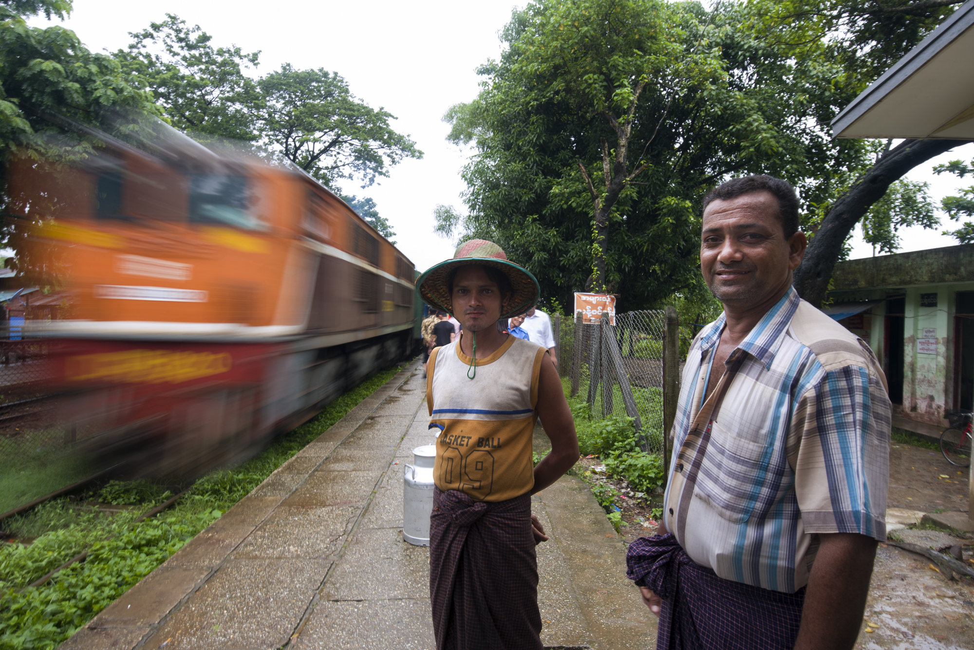 A milk salesman and his employee transport fresh mil from their farm into the city each morning using the train network