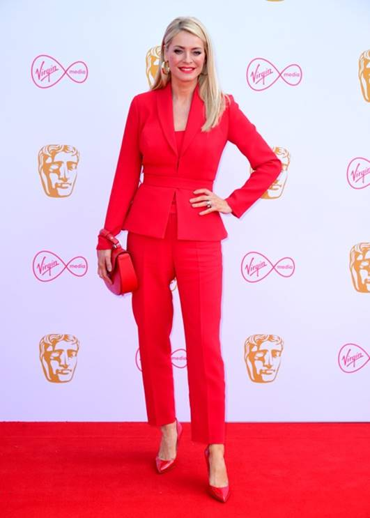 Tess Daly in bespoke trouser suit by Suzanne Neville & Kurt Geiger shoes