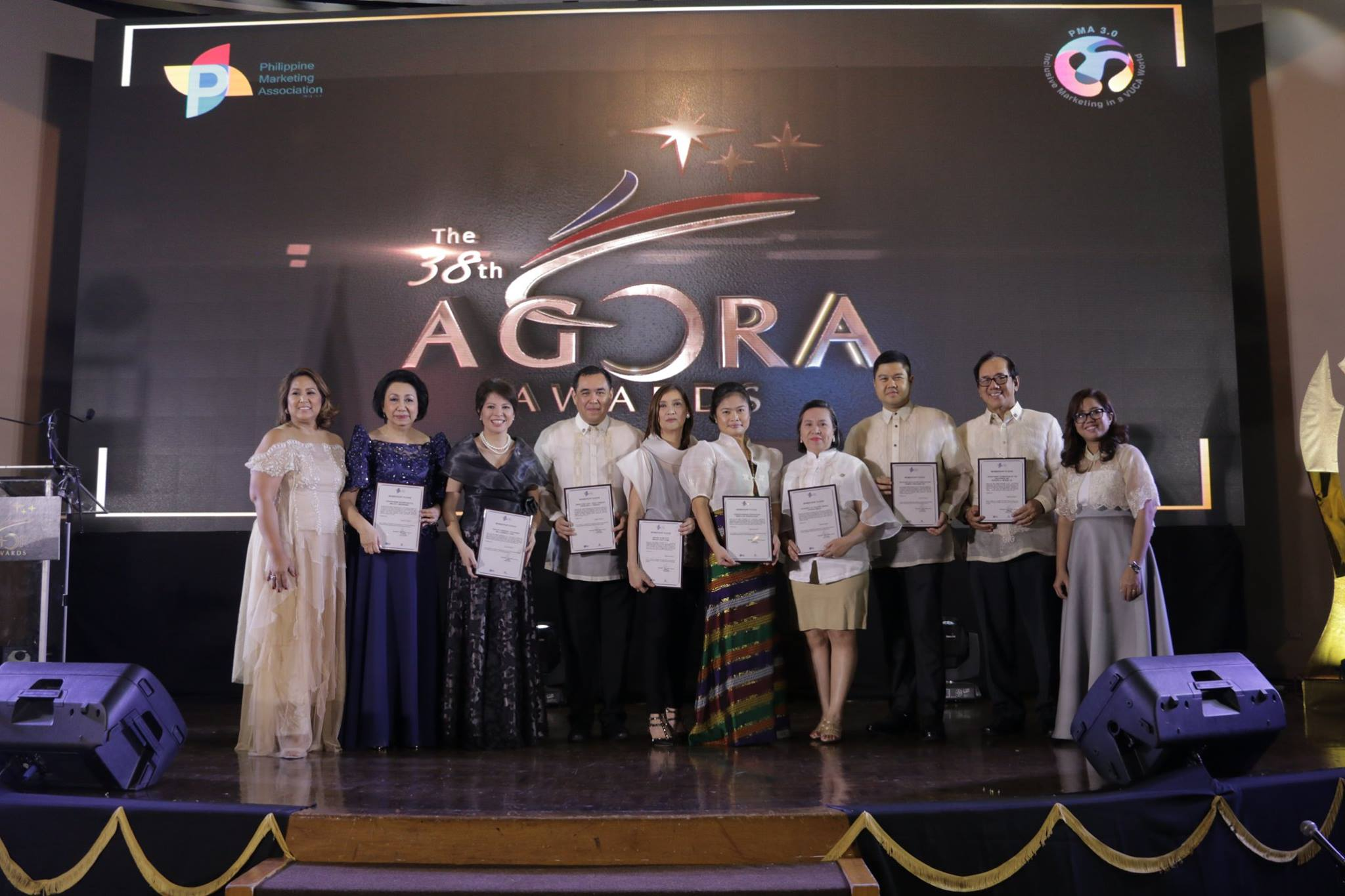 The 38th Agora Awardees with Philippine Marketing Association 2017 President Arlene Padua and 2017 Agora Director, Amrei Dizon  Outstanding Achievement in Entrepreneurship - Small Scale: Mr. Jorge Noel Wieneke, Founder of  Tokyo Tempura   Outstanding Achievement in Export Marketing: Fisher Farms PH   Outstanding Achievement in Marketing Management: Ms. Mylene Lopa, Chief Marketing Officer of  Sun Life Financial Philippines   Outstanding Achievement in Entrepreneurship - Medium Scale: Ms. Haraya Del Rosario-Gust  StraightArrow Corporation   Outstanding Achievement in Marketing Communications: Ms. Merlee Cruz-Jayme, CEO of  Dentsu Jayme Syfu   Outstanding Achievement in Marketing Education: Prof. Cynthia Abella, Associate Professor of the College of Business Administration, University of the East (UE)   Outstanding Achievement in Advocacy Marketing: Advertising Foundation of the Philippines  Jun Nicdao   Outstanding Achievement in Entrepreneurship - Large Scale: Dr. Roberto Macasaet Sr., Founder and Chairman of  Maxicare Healthcare Corporation   Honorary Agora for Nation-Building: DTI Philippines Secretary, Mr. Ramon Lopez