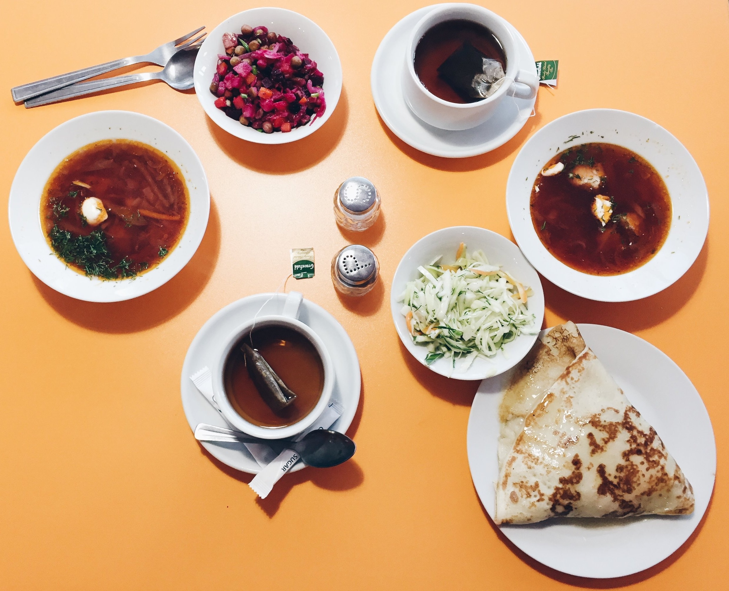 Soup:   Borscht   Salads:   Beet  (left); Cabbage  (right)  Blini:   Ham, mushroom, and cheese  Drink :  Black h   oney tea
