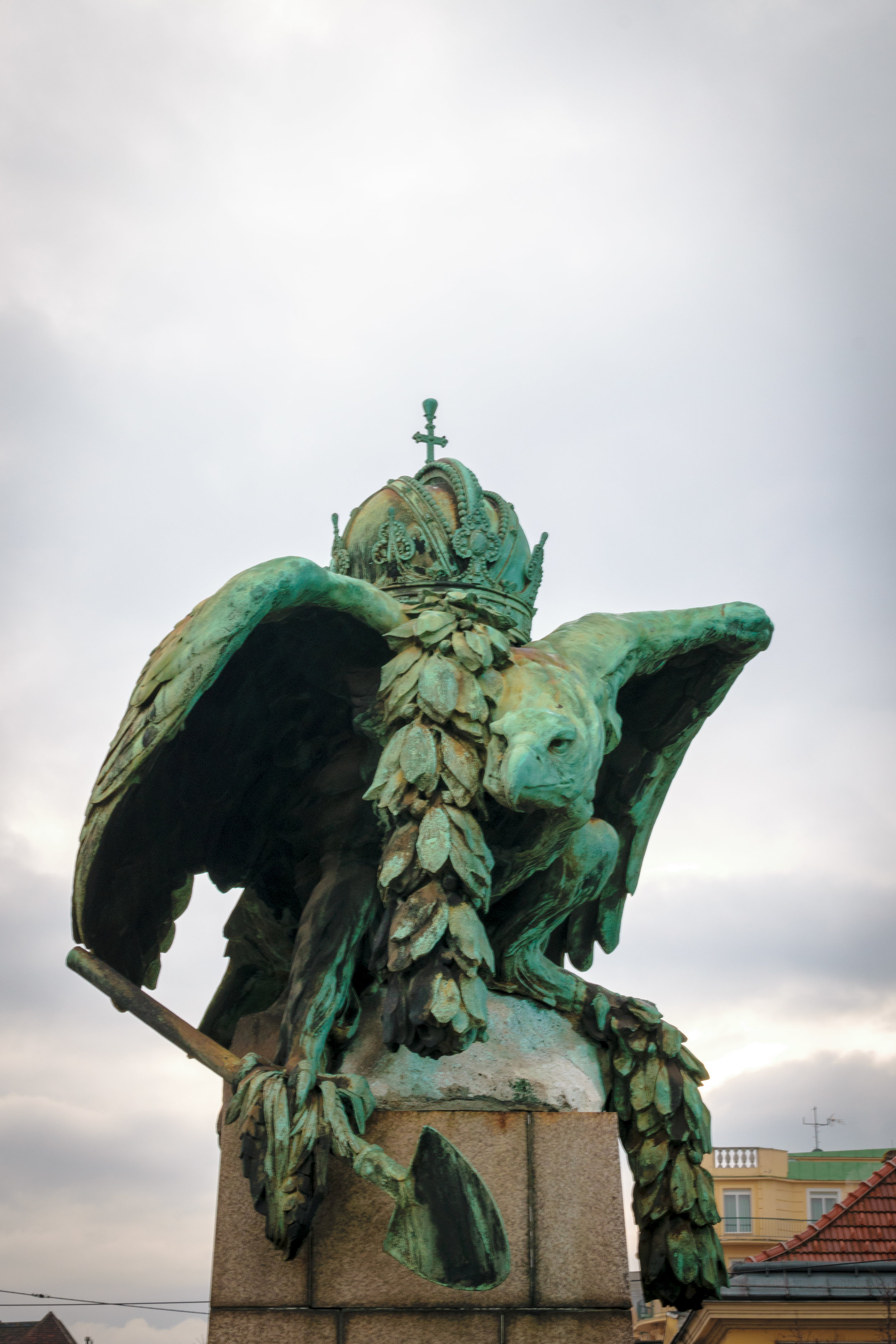a royal eagle rests on a bridge