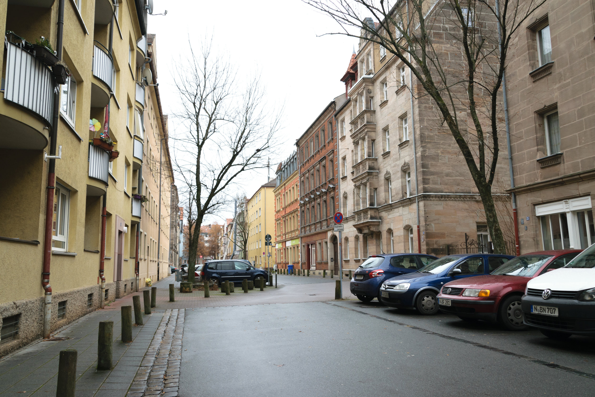 without a straight path, cars must slow down to maneuver through the narrow street