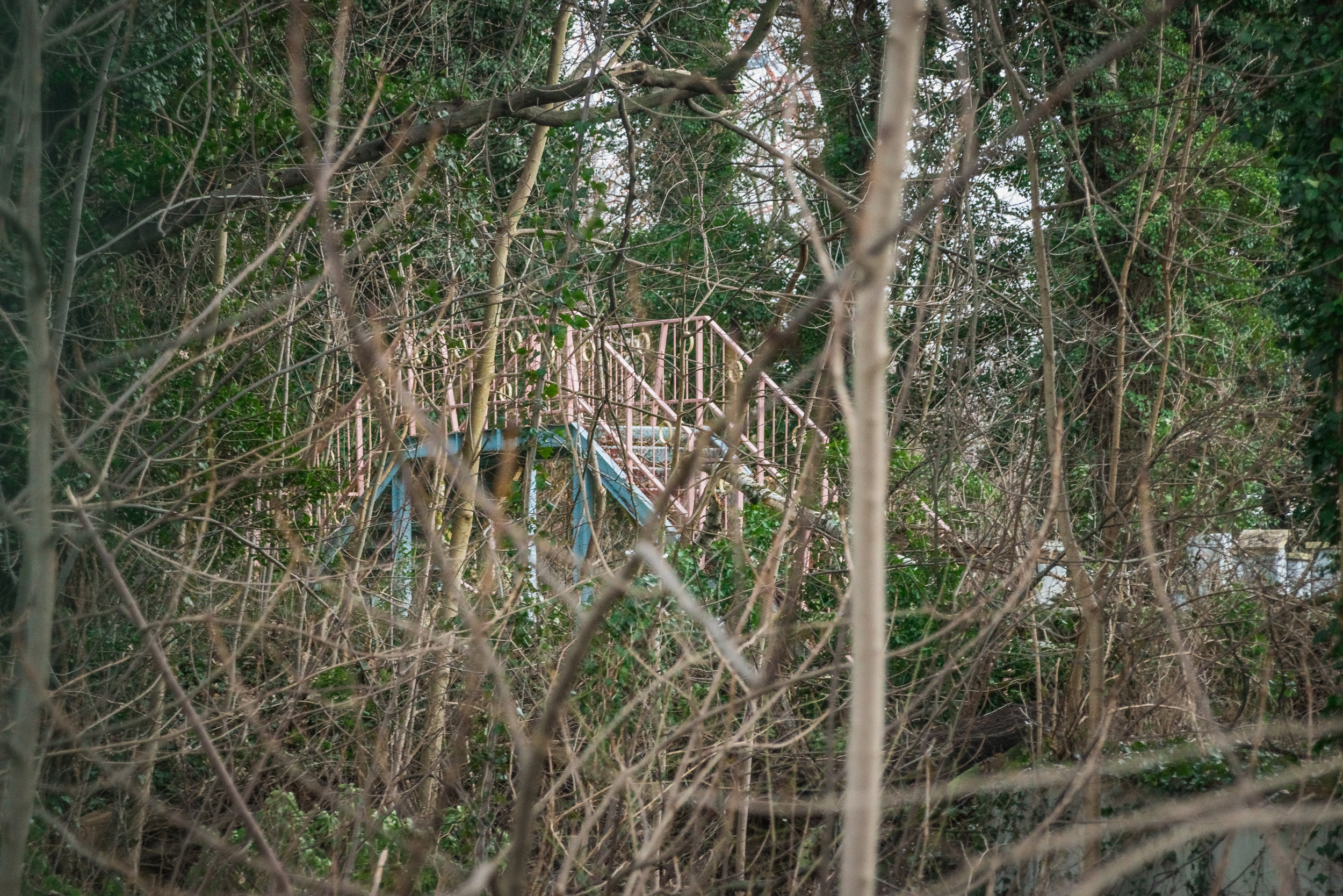 the very 1980s baby blue & pink wrought iron bridge