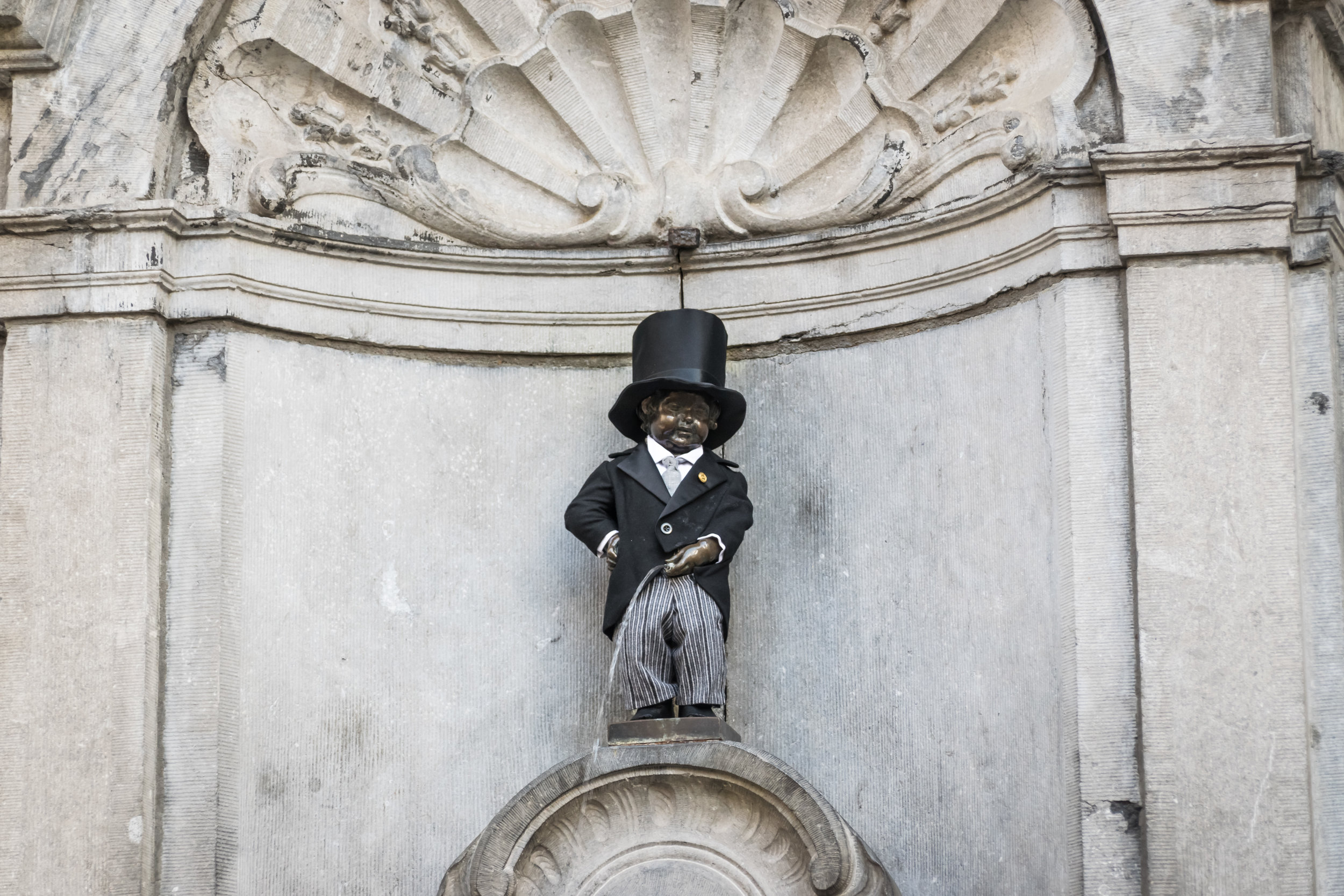 Manneken Pis, originally a water fountain and now a city symbol