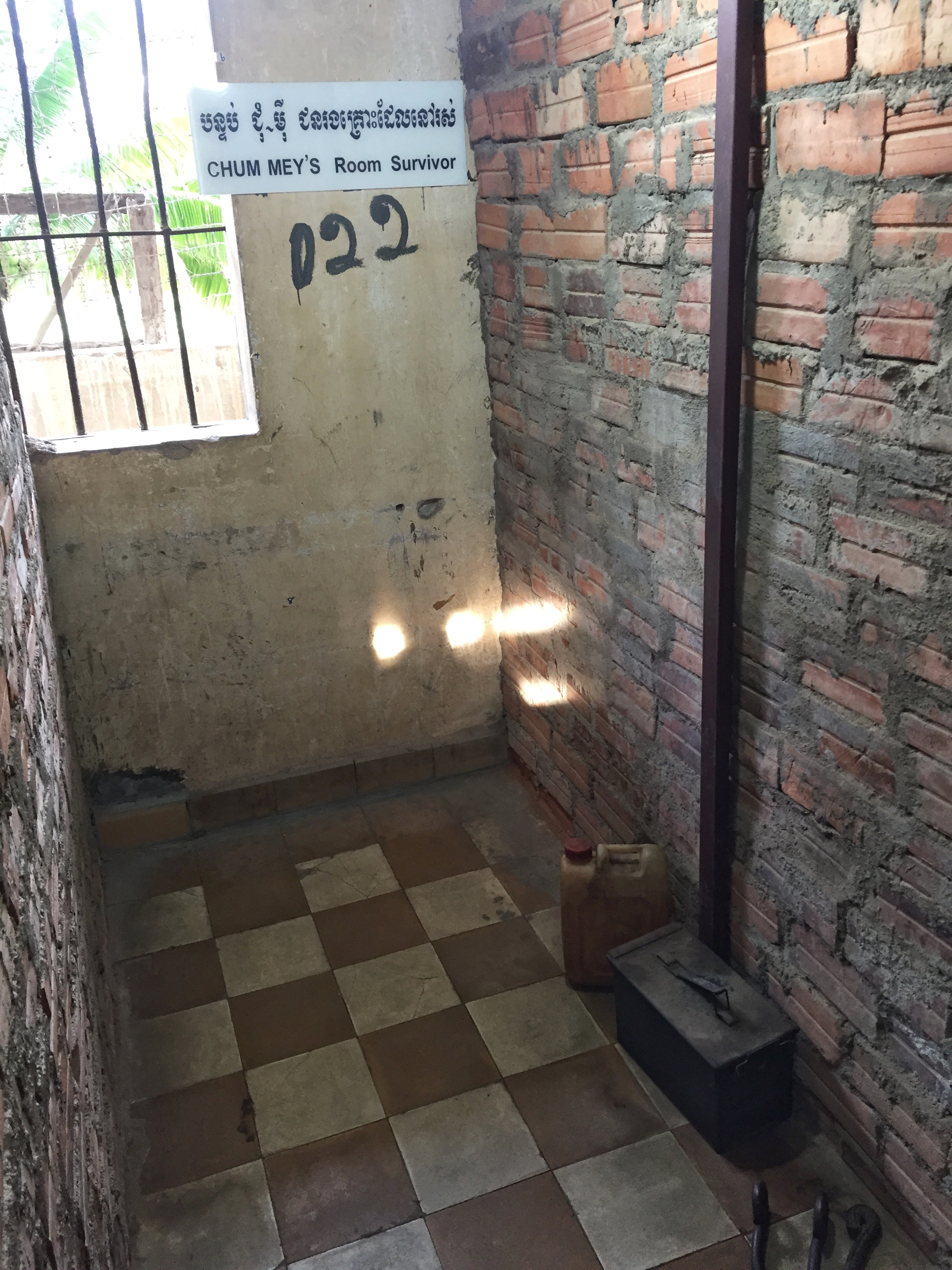 notable prisoner's cell; he and other prisoners sat on the floor with their hands and feet shackled