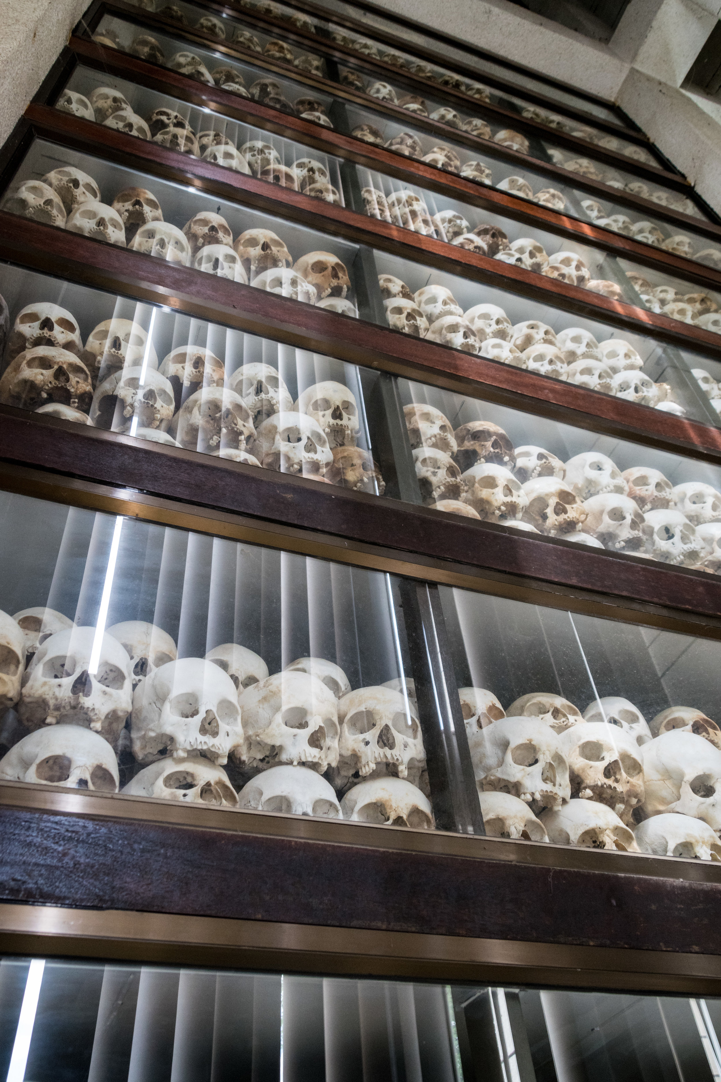carefully preserved skulls of victims inside the Memorial Stupa
