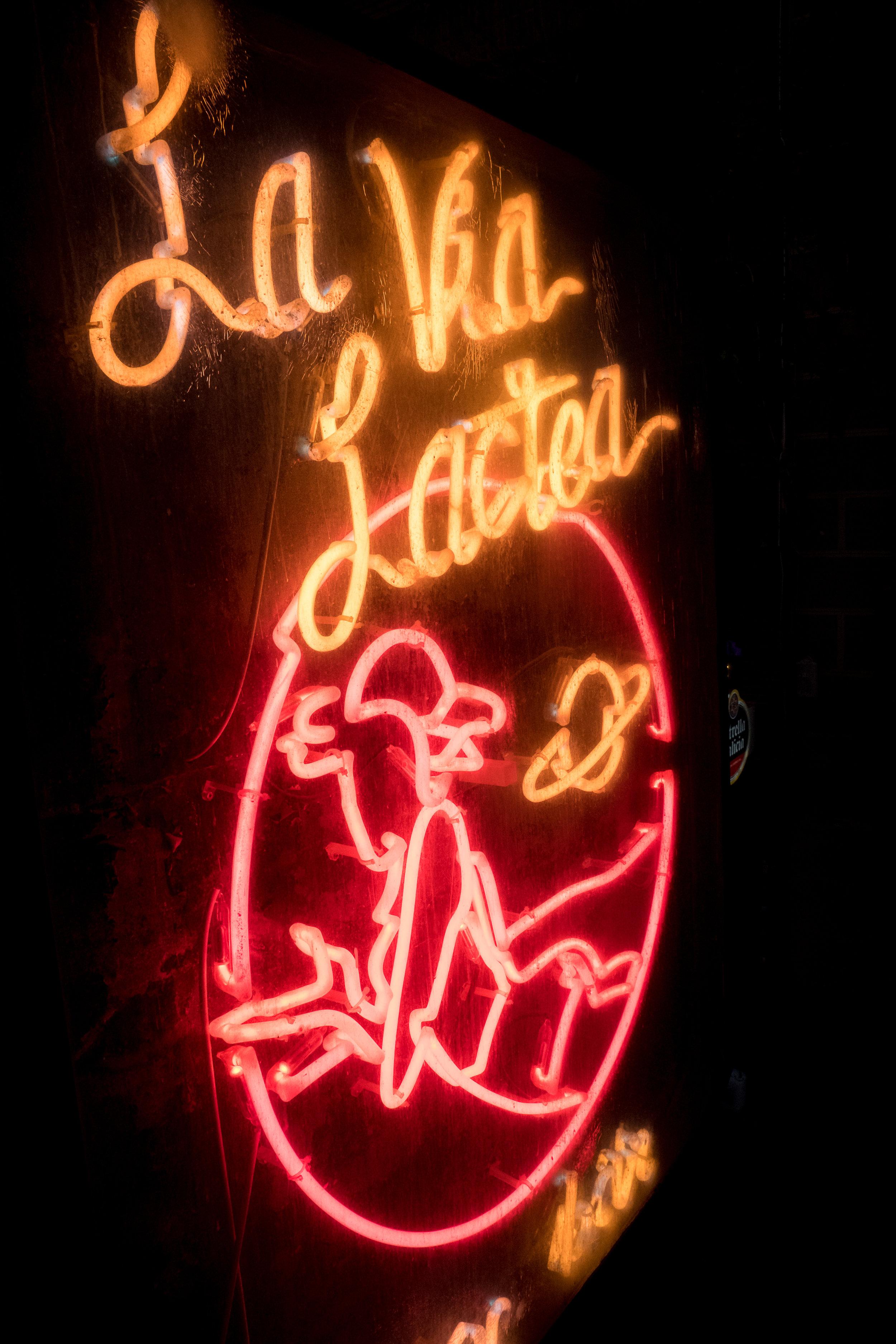 neon sign outside of bar La Vía Láctea